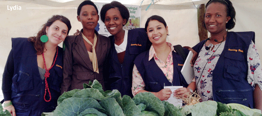 Lydia, second from the left, posing in front of her own farming produce (Photo Courtesy of Equality Now!)