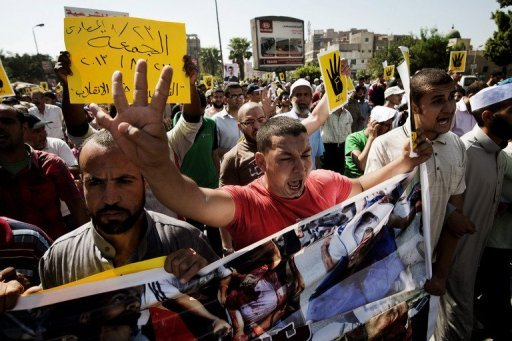 "Pro-Morsi demonstrators announced Tuesday protests under the title ""The Coup is Terrorism."" (AFP/Gianluigi Guercia)"