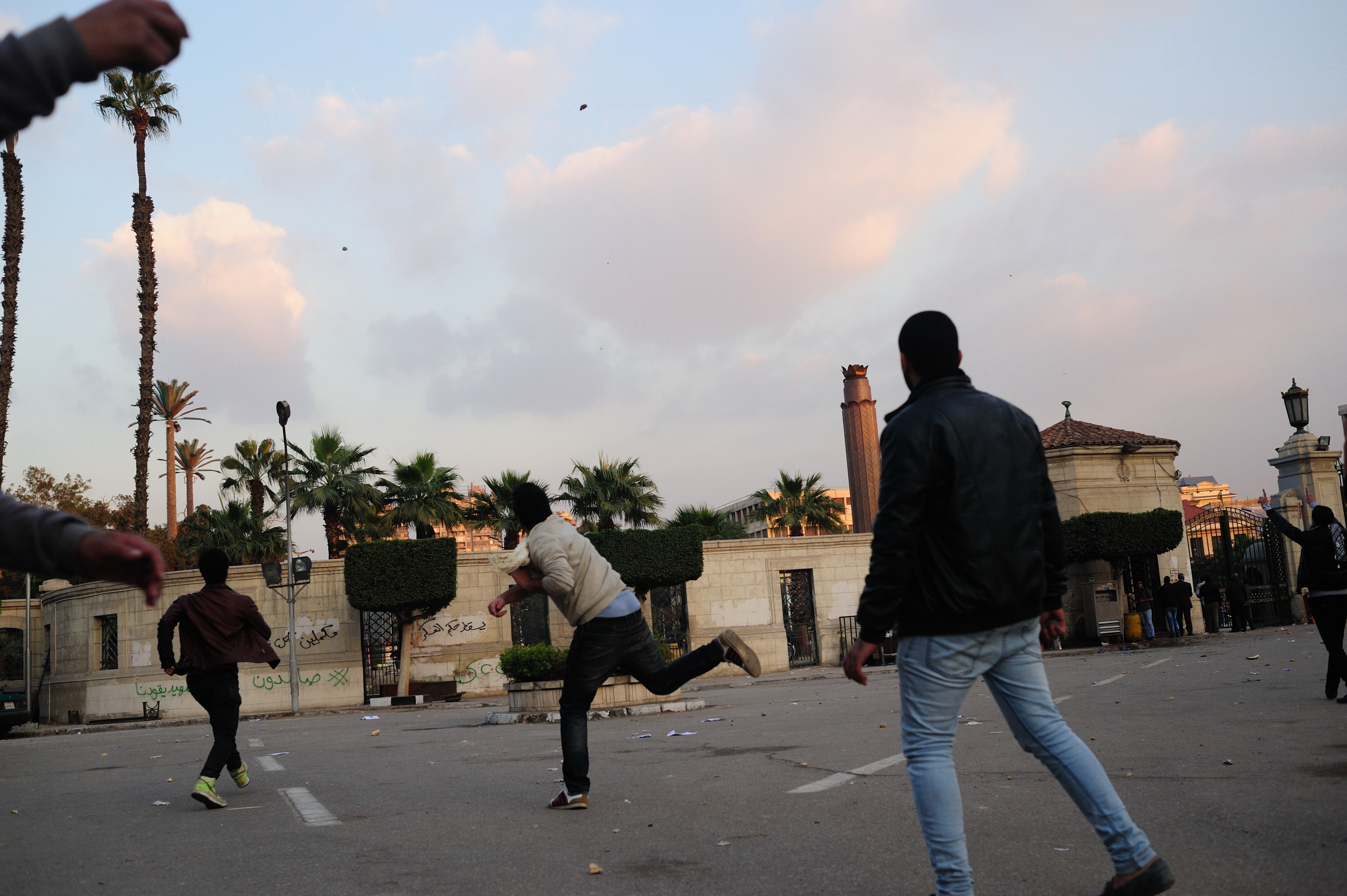 Students clash with security forces outside Cairo University on 12 January.  (Photo by Ahmed Al-Malky)