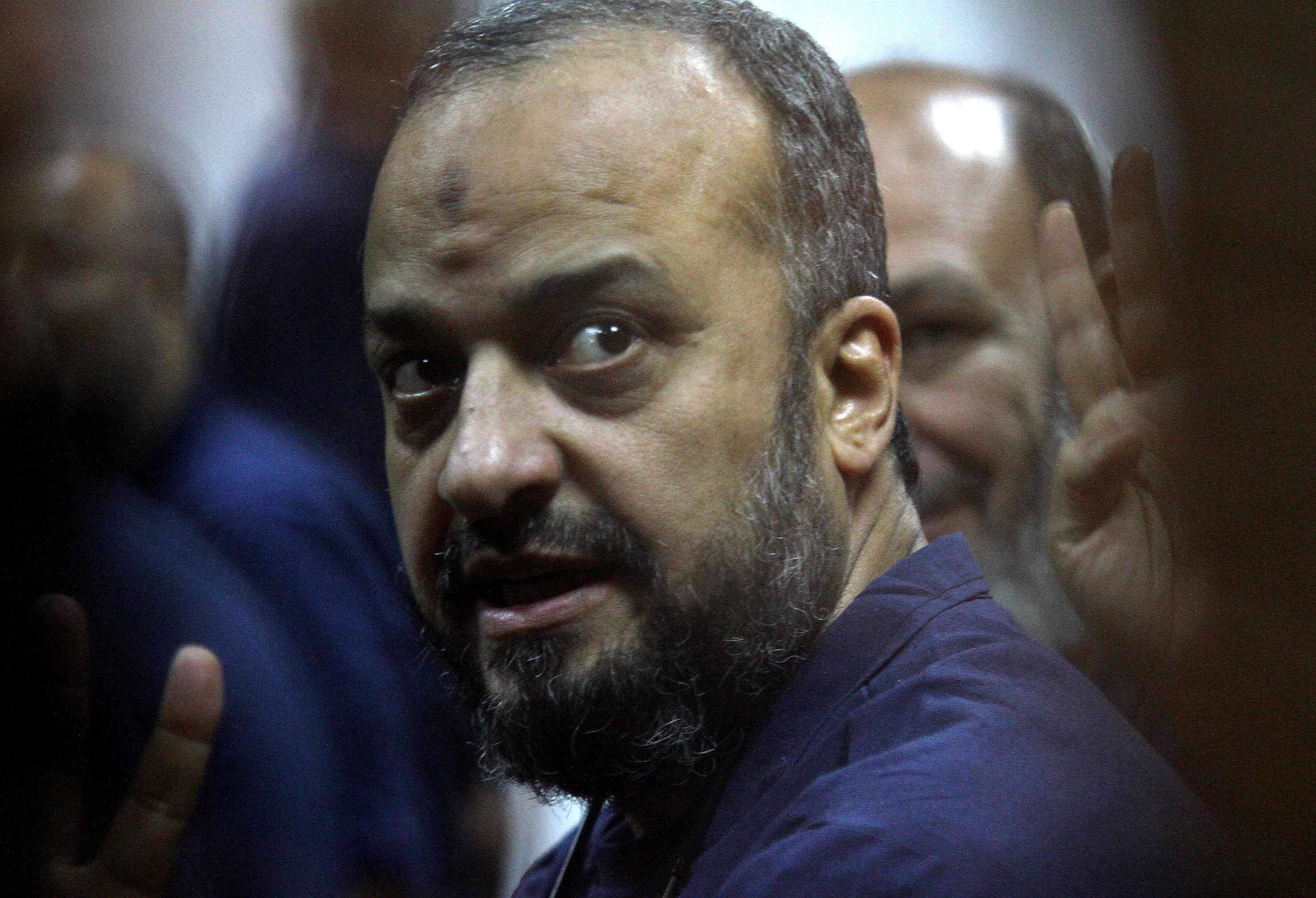 Egyptian Muslim Brotherhood politician Mohamed Al-Beltagy sits inside the defendants' cage during his trial at a police academy in Cairo on Thursday.  (AFP PHOTO / TAREK EL-GABASS)