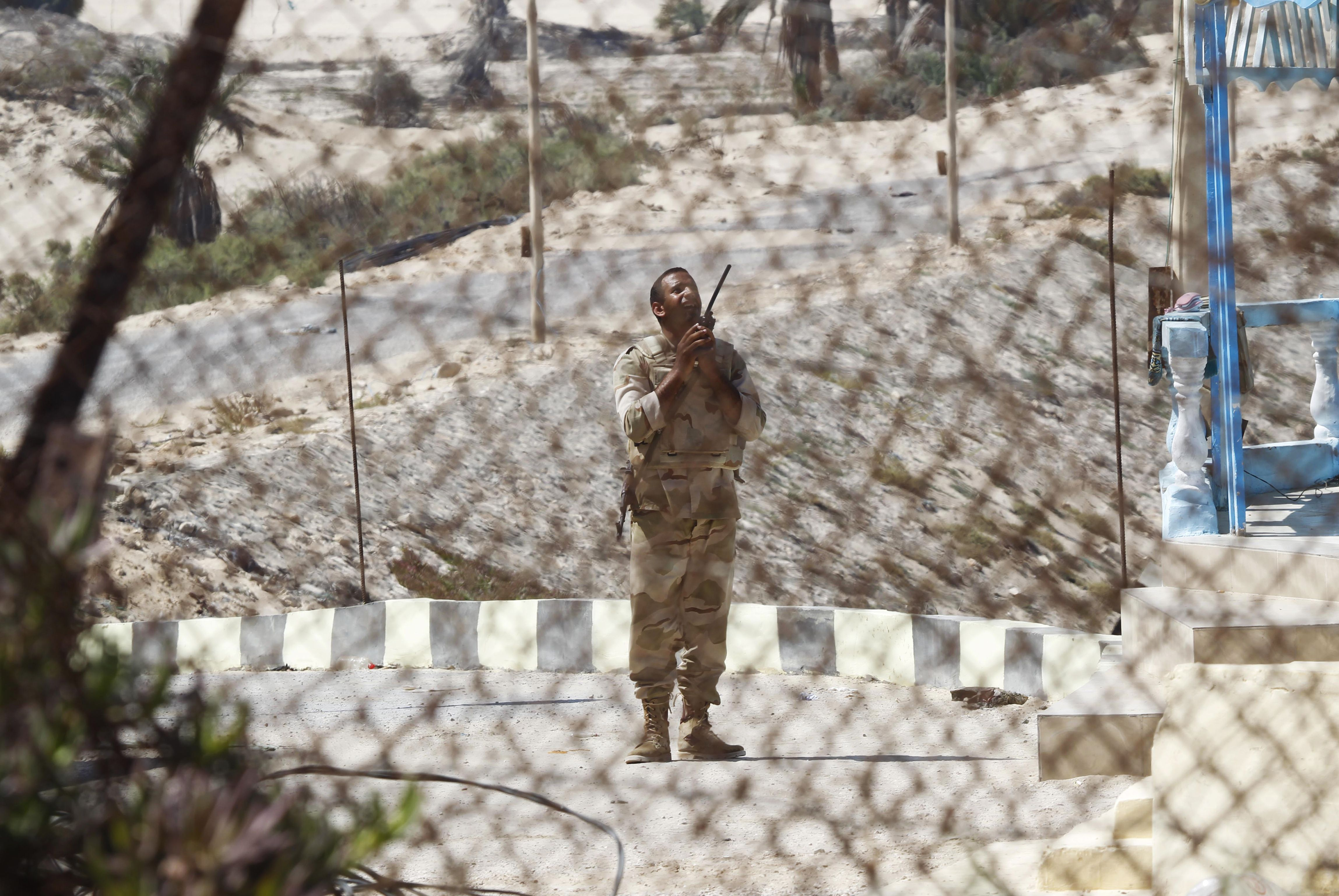 A picture taken from the southern Gaza Strip shows an Egyptian soldier standing guard on the border between Egypt and the Palestinian territory on Thursday.  (AFP PHOTO / SAID KHATIB)