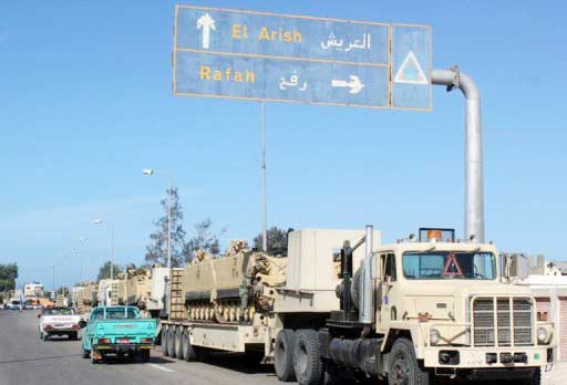 Trucks transporting armored personnel carriers on the road between Rafah and Arish in North Sinai (AFP Photo)