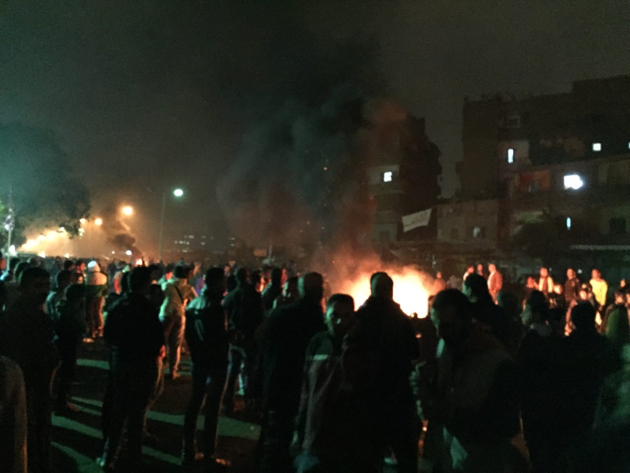 Clashes Sunday at Matariya Square left at least 12 protesters dead. Photo shows a gathering of demonstrators around a fire. Photo provided to Daily News Egypt by a protester