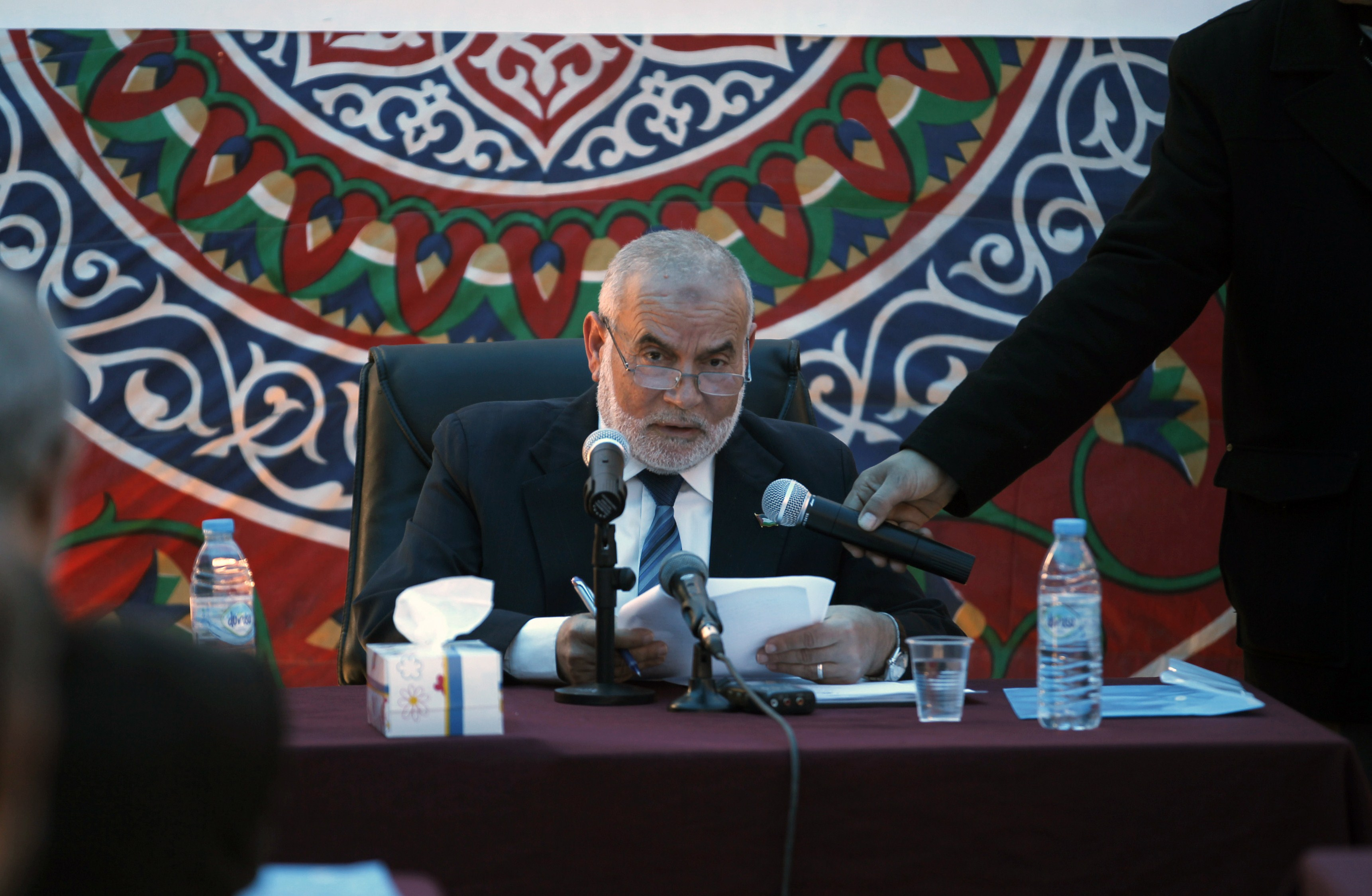 Ahmad Bahar, deputy parliament speaker and Hamas member, speaks during a special session, attended by Hamas MPs, in a tent at Rafah on February 23, 2014, to demand that Egypt lift border crossing restrictions. Egypt imposed the restrictions as part of a campaign by its security forces against jihadists in the lawless Sinai Peninsula, which borders Gaza and Israel.  (AFP PHOTO / SAID KHATIB)