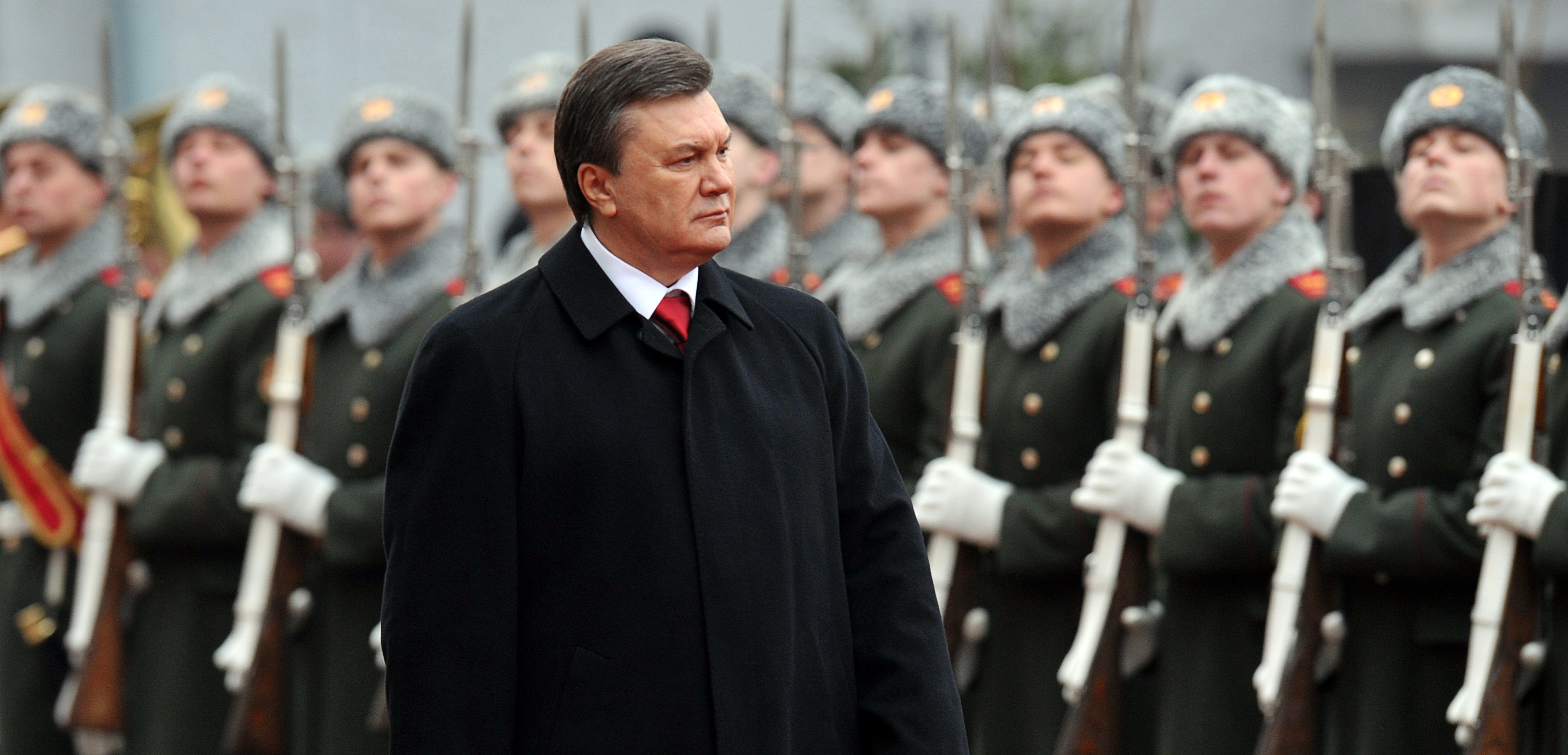 "Ukraine's President Viktor Yanukovych reviews an honour guard during his inauguration ceremony in Kiev on February 25, 2010.   Ukraine issued an arrest warrant on February 24, 2014 for ousted president Viktor Yanukovych over the ""mass murder"" of protesters and appealed for $35 billion in Western aid to pull the ex-Soviet country back from the brink of economic collapse. The dramatic announcements by ex-Soviet country's new Western-leaning ministers -- approved by parliament over a chaotic weekend that saw the pro-Russian leader flee into hiding -- came as a top EU envoy flew to Kiev to buttress its sudden tilt away from Moscow.   (AFP PHOTO/ SERGEI SUPINSKY)"
