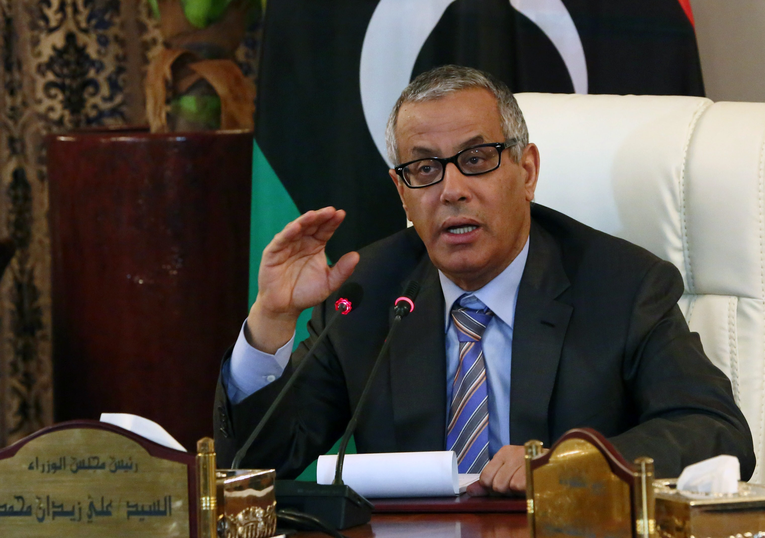 Libyan Prime Minister Ali Zaidan speaks during a press conference with Interior Minister following a rocket attack on a building located in a residential area on July 24, 2013 in Tripoli, Libya. (AFP Photo)