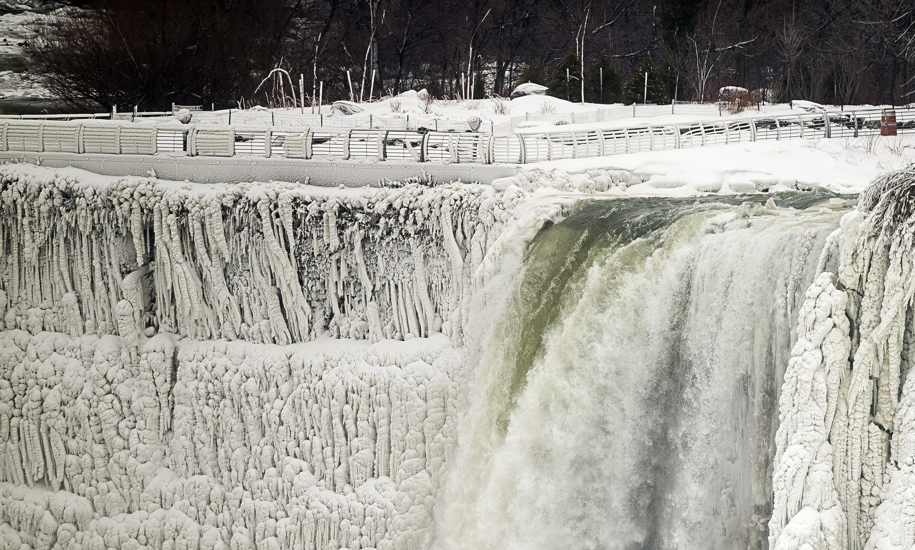 Water still cascades over Niagara Falls on 10 January 2014. The famous falls at the US-Canadian border nearly froze during the recent cold snap which affected some 240 million people in the US and southern Canada . (AFP PHOTO/GEOFF ROBINS)