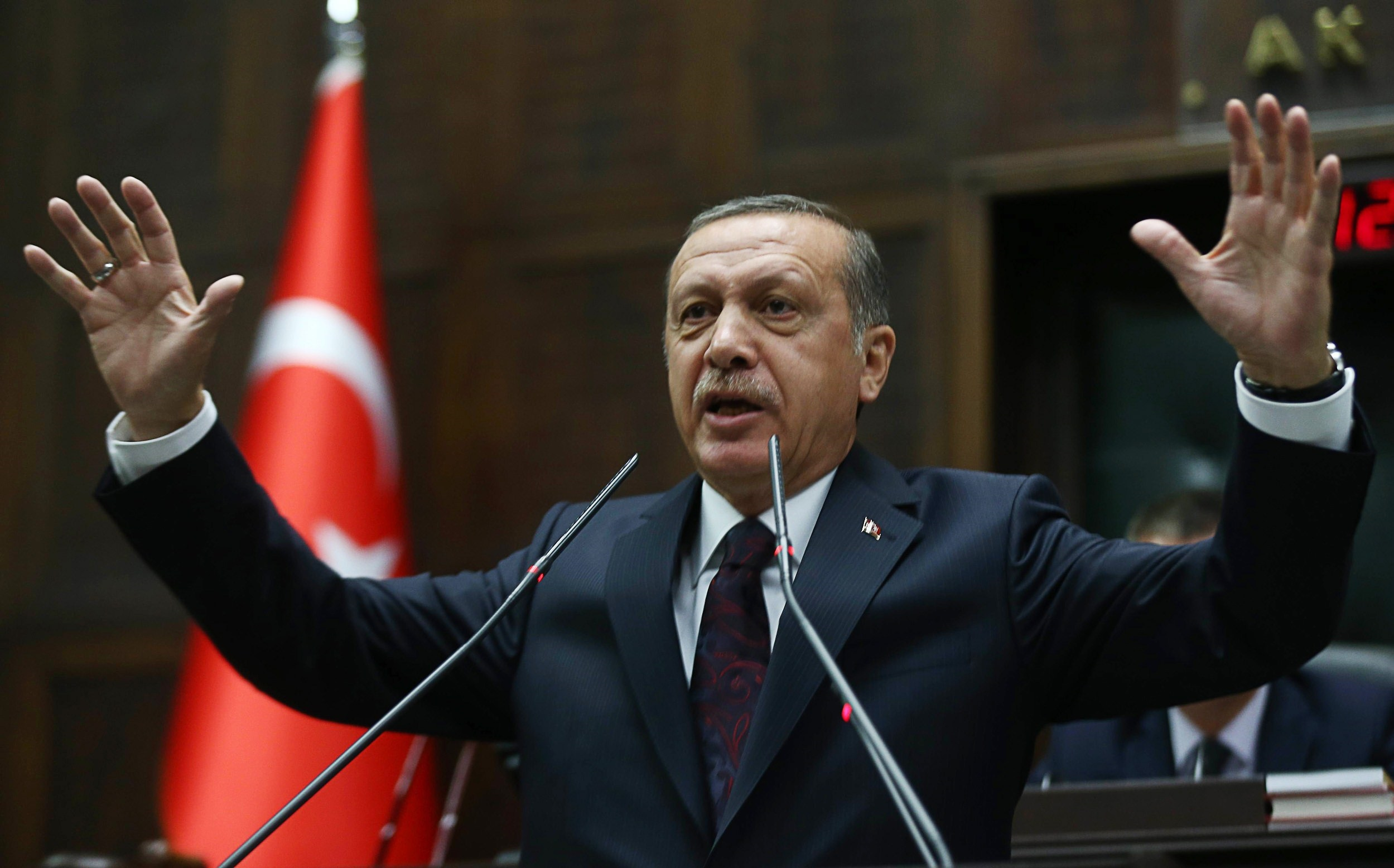 Turkey's Prime Minister Recep Tayyip Erdogan speaks to members of parliament from his ruling Justice and Development (AKP) Party during a meeting at the Turkish parliament in Ankara on 8 April 2014. (AFP PHOTO )