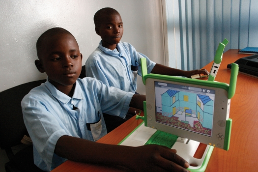 Rwandan children learn computers in class. (Photo Courtesy of One Laptop per Child (OLPC) )