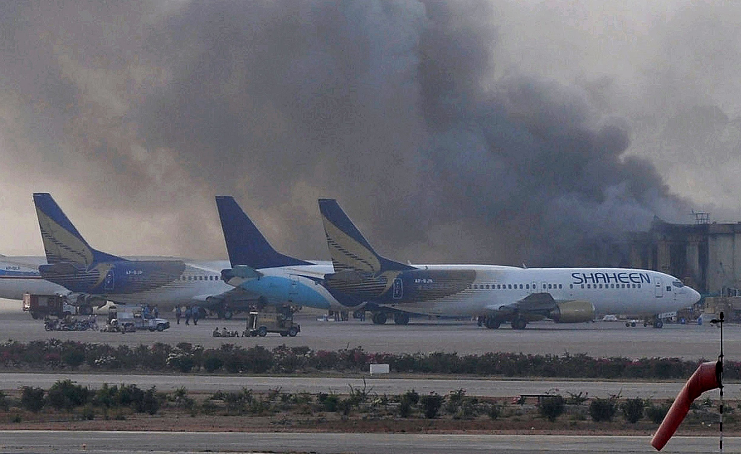 Smoke rises after militants launched an early morning assault at Jinnah International Airport in Karachi on June 9, 2014.  Pakistan's security forces said on June 9 they have relaunched a military operation at Karachi airport as gunfire resumed several hours after they announced the end of a militant siege that left 24 dead.       (AFP PHOTO / Rizwan TABASSUM)