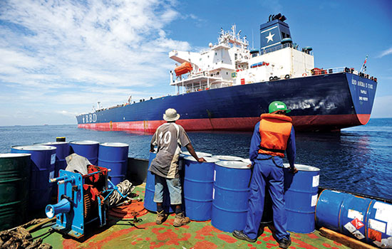 A crew member prepares to board the RBD Anema E Core in the Lomé anchorage; the tanker was hijacked by pirates in Benin in 2011 (IRIN/Daniel Hayduk)