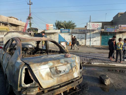 The site of a car bomb in Bayaa, a predominantly Shiite neighbourhood of west Baghdad, on 3 December  (AFP Photo, Sabah Arar)