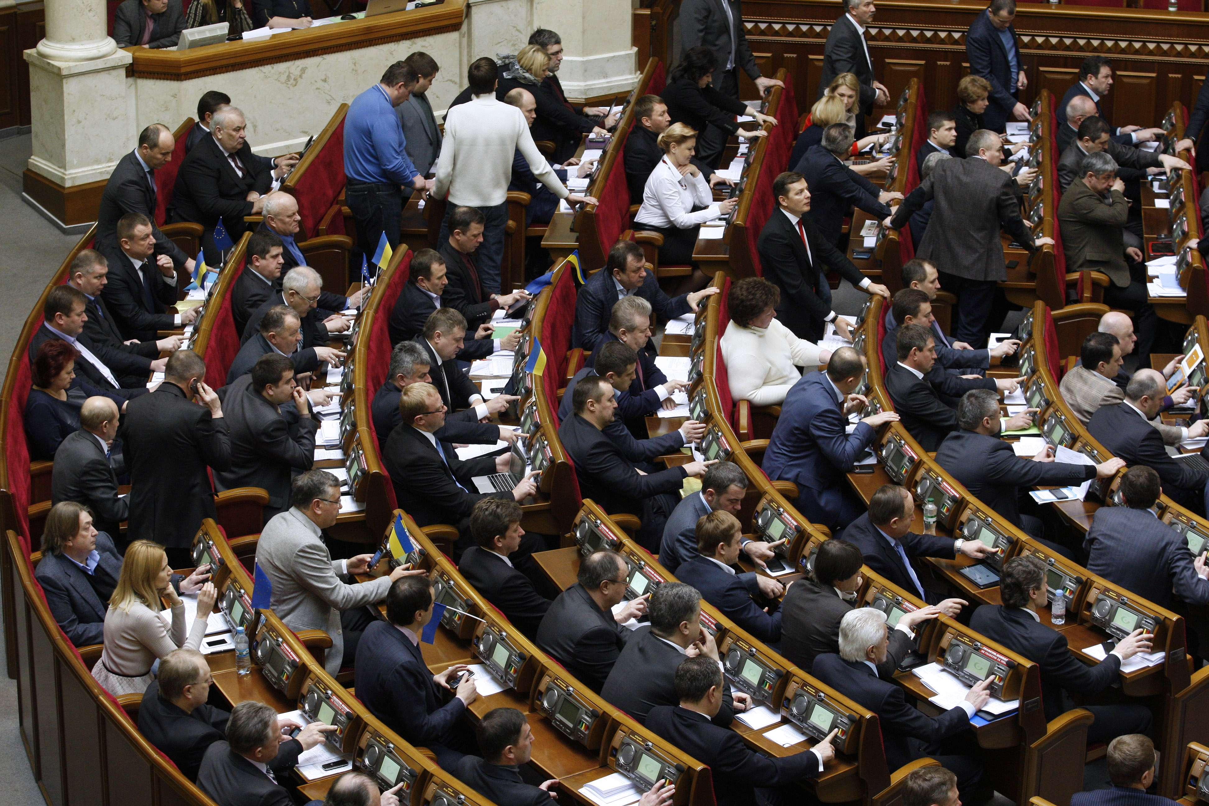 Ukraine's MPs attend a parliamentary session on Monday, in Kiev. Ukrainian troops will remain in Crimea, the country's defence minister said that day even as media reported the separatist peninsula planned to disband Ukrainian units there ( AFP PHOTO/ YURY KIRNICHNY)