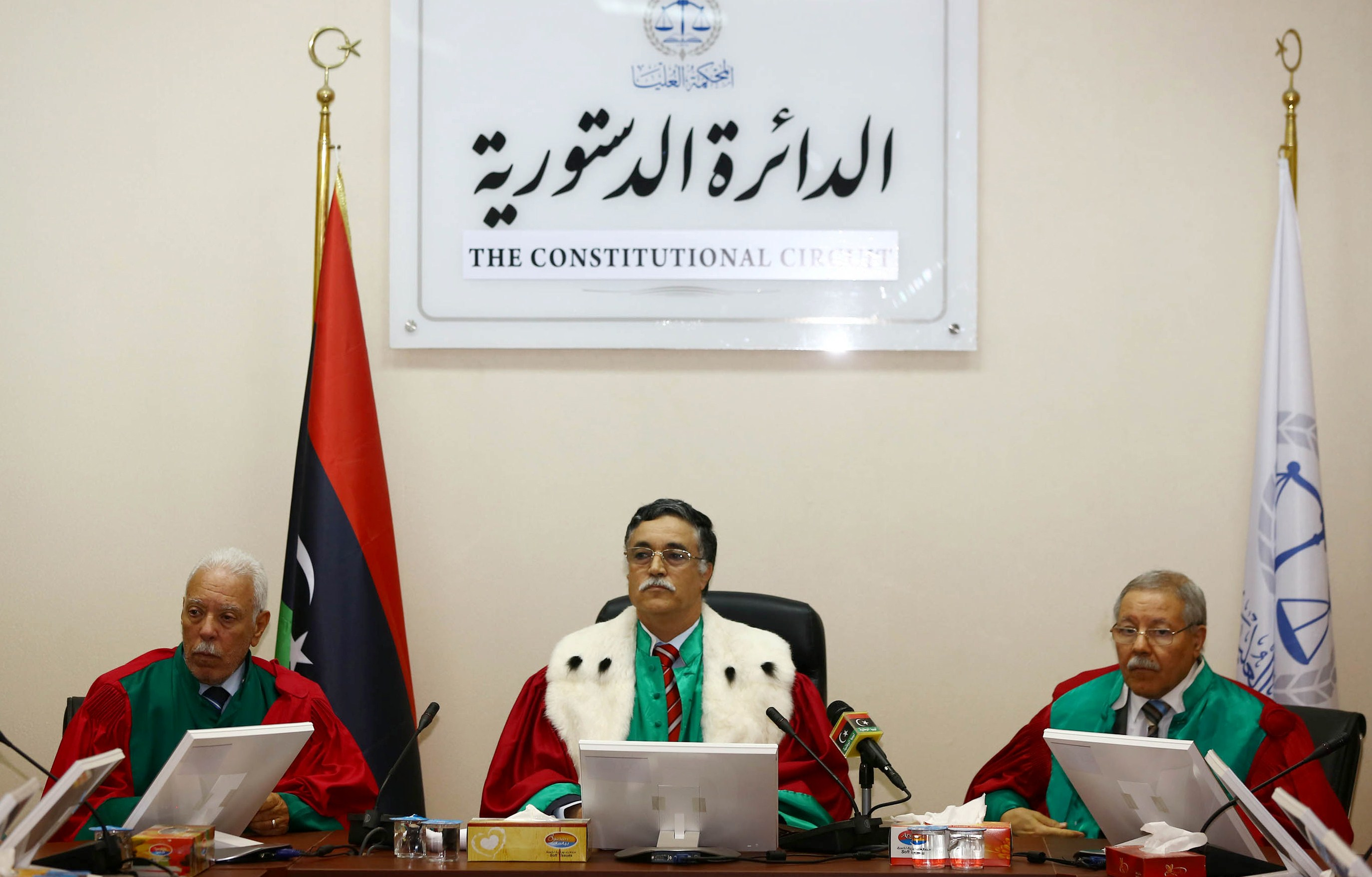 President of Libya's supreme court, Kamal Edhan (C) chairs a hearing to discuss the legitimacy of the prime minister on June 9, 2014 in the capital Tripoli. The court ruled that the election of prime minister Ahmed Miitig in a chaotic session in the interim parliament in early May was unconstitutional. (AFP PHOTO / MAHMUD TURKIA)