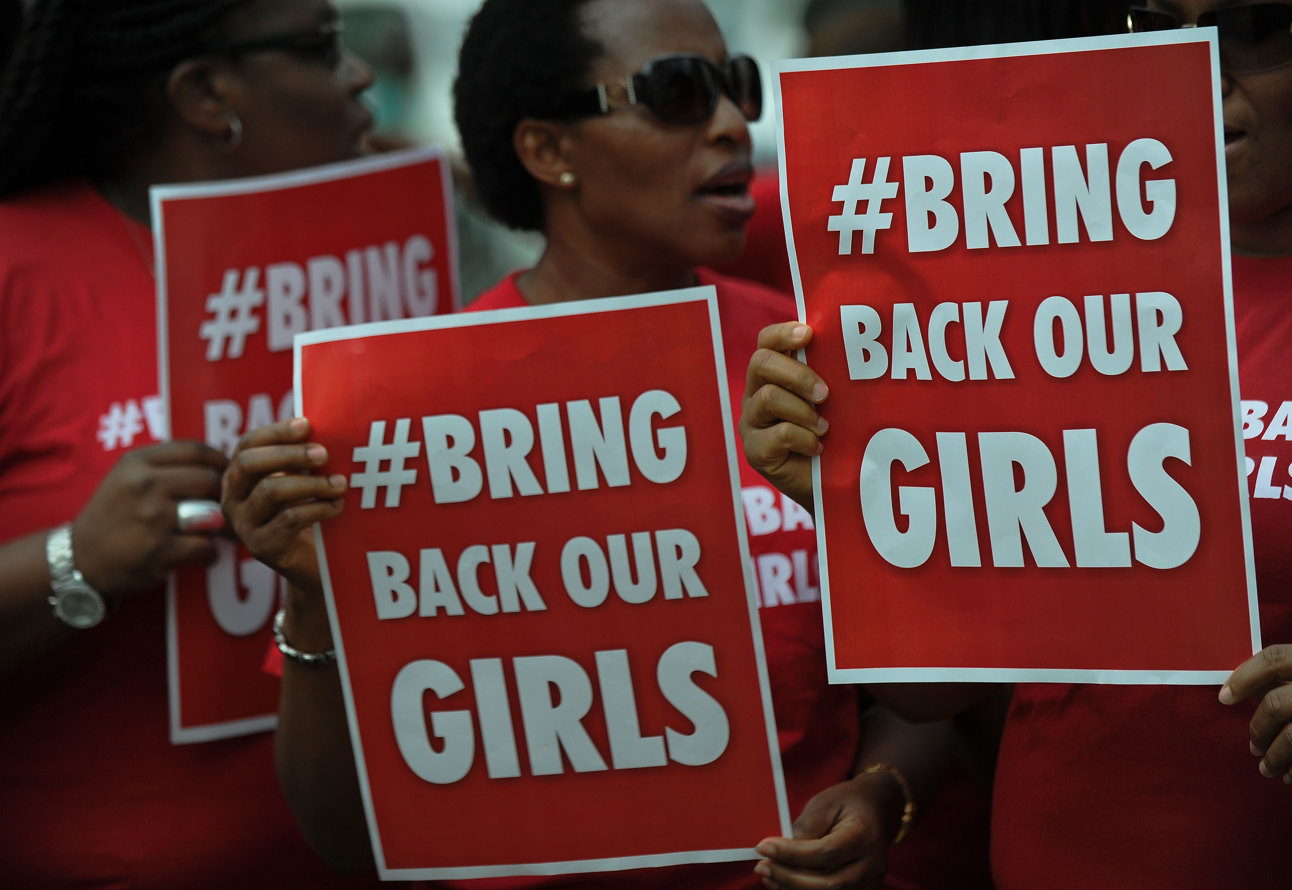 Nigerian women living in Kenya demonstrate to press for the release of Nigerian school girls kidnapped in nothern Nigeria by members of the Boko Haram, on May 16, 2014 in Nairobi.  (AFP PHOTO/Tony KARUMBA)