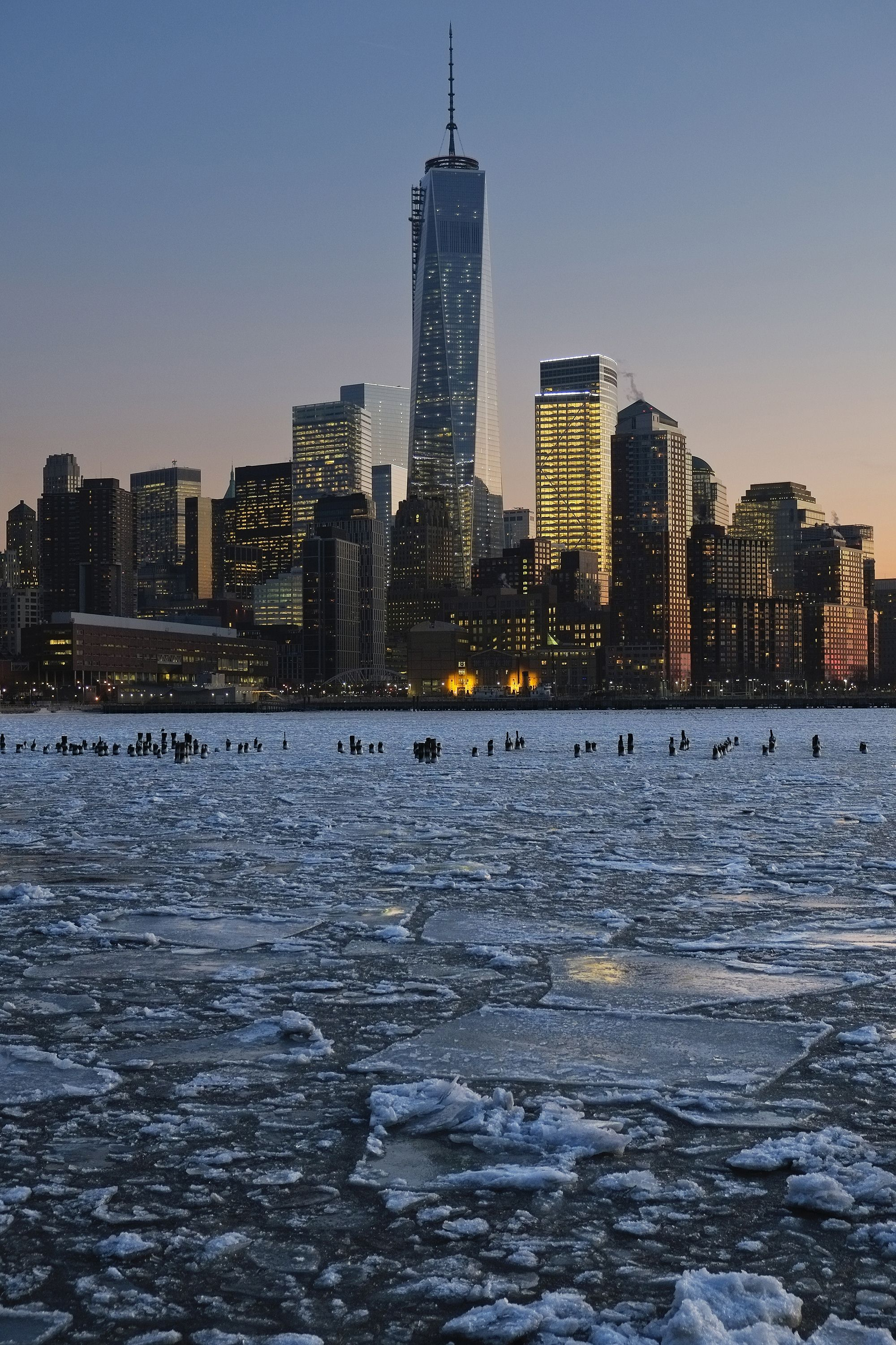 Ice floes fill the Hudson River as the Lower Manhattan skyline is seen during sunset on 9 January 2014 in New York City.A recent cold spell, caused by a polar vortex descending from the Arctic, caused the floes to form in the Hudson.