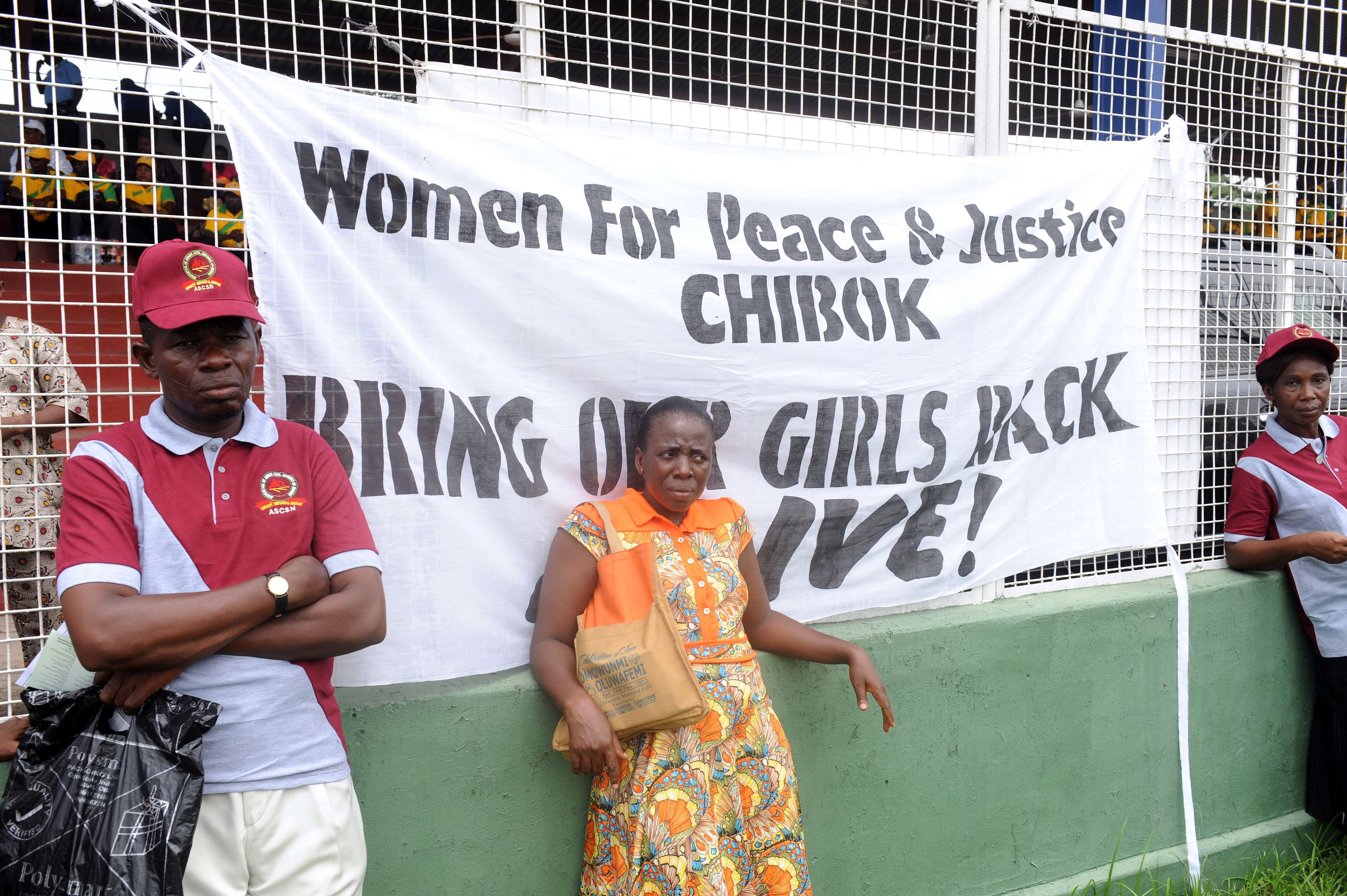Workers lean on a banner as they press for the release of the schoolgirls kidnapped by Boko Haram more than two weeks ago during a workers' rally in Lagos on May 1, 2014.  (AFP Photo)