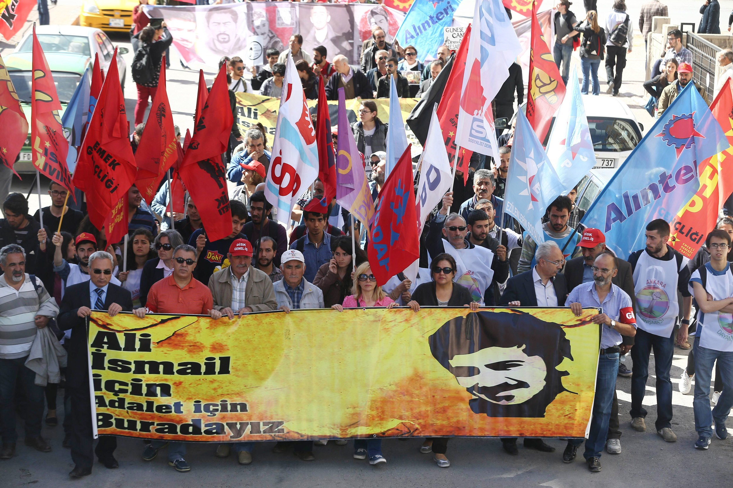 """Thousands of people holding placards reading """"We are here for Ali Ismail and for justice"""" gather in Kayseri on Monday, outside the court where four of the Turkish riot police are on trial for allegedly beating to death Ali Ismail Korkmaz  (AFP PHOTO/ADEM ALTAN)"""