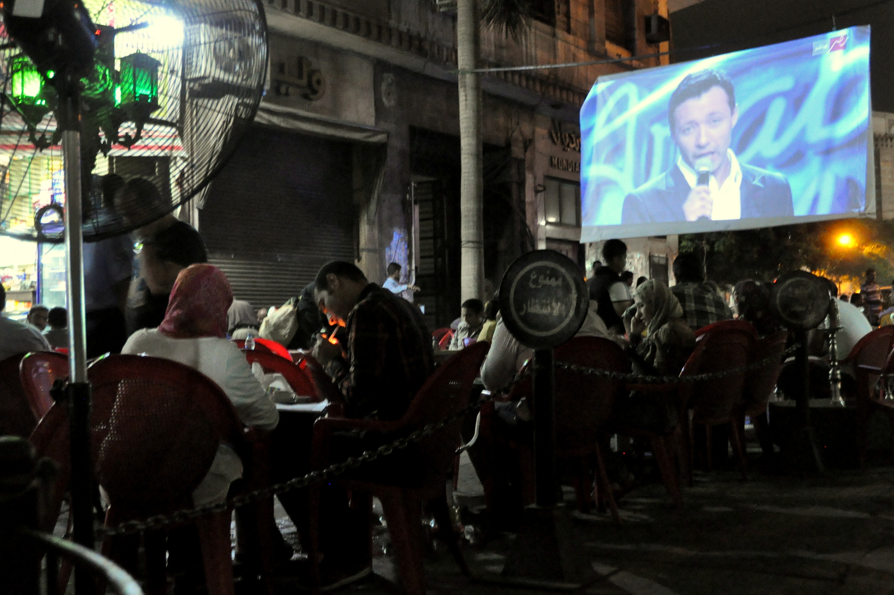 Cafe patrons watch Arab Idol at an outdoor cafe in El Borsa, Downtown, Cairo (Photo By Aaron T Rose)