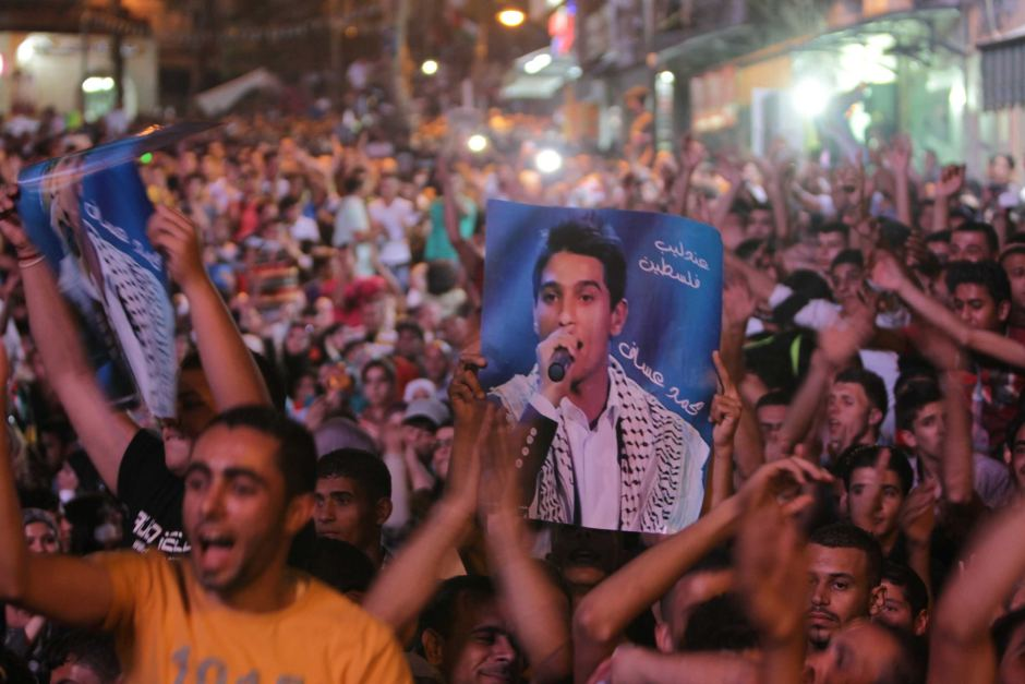 Thousands of Palestinians celebrate the victory in the Arab Idol contestant of Mohammed Assaf on Saturday night  (AFP PHOTO/ABBAS MOMANI)