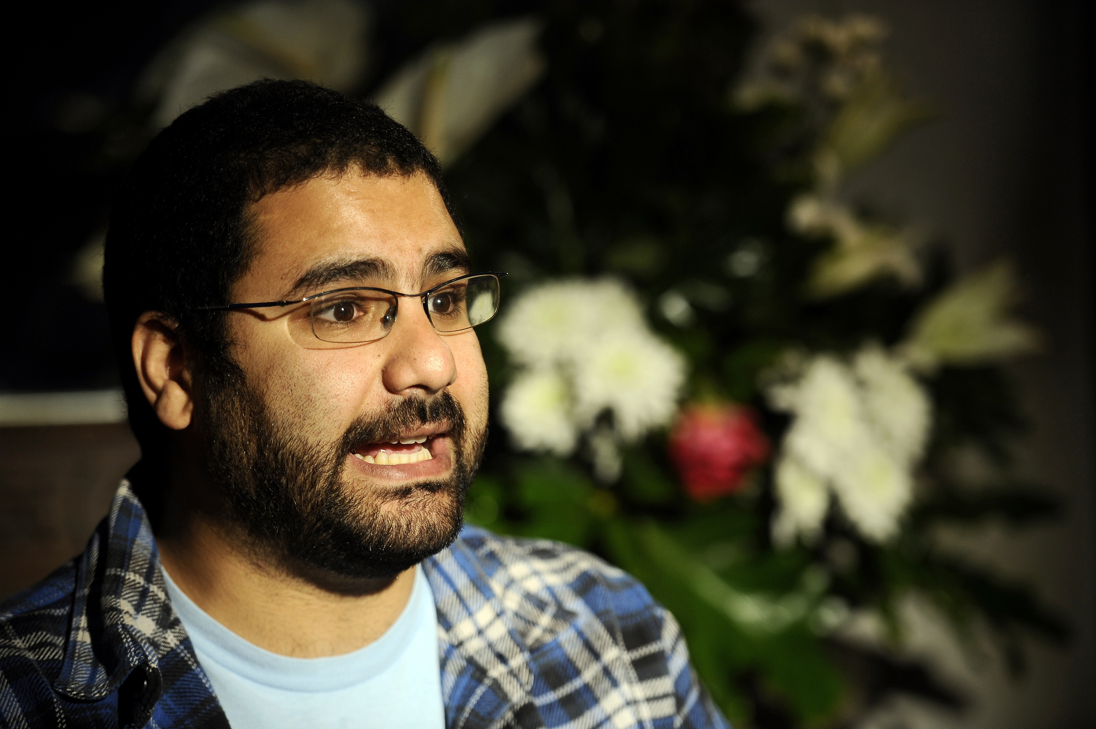 A photo take on December 26, 2011, shows Egyptian blogger and activist Alaa Abdel Fattah speaking during a TV interview at his house in Cairo, a day after his release. A leftwing activist who played a prominent role in the 2011 uprising against Hosni Mubarak stands trial on March 23, 2014, amid a crackdown on protests by the new military-installed regime.   (AFP PHOTO / Filippo MONTEFORTE)