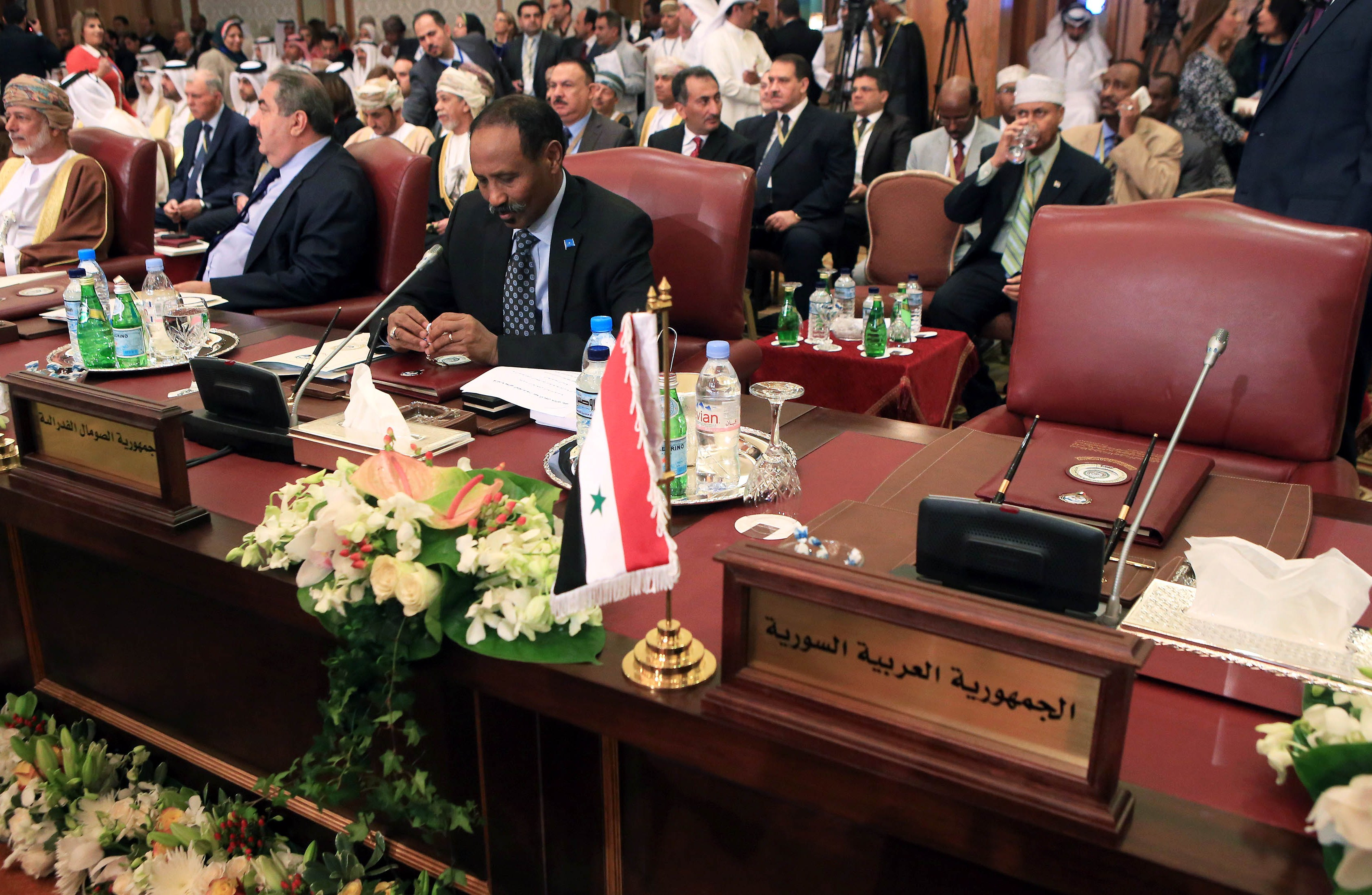 Somalian Foreign Minister Abdirahman Udale Bayle (C) sits next to empty Syrian seat at the opening session of the Arab League Foreign ministers's meeting in preparation for the Arab Summit in Kuwait City, on March 23, 2014.  (AFP PHOTO/YASSER AL-ZAYYAT)