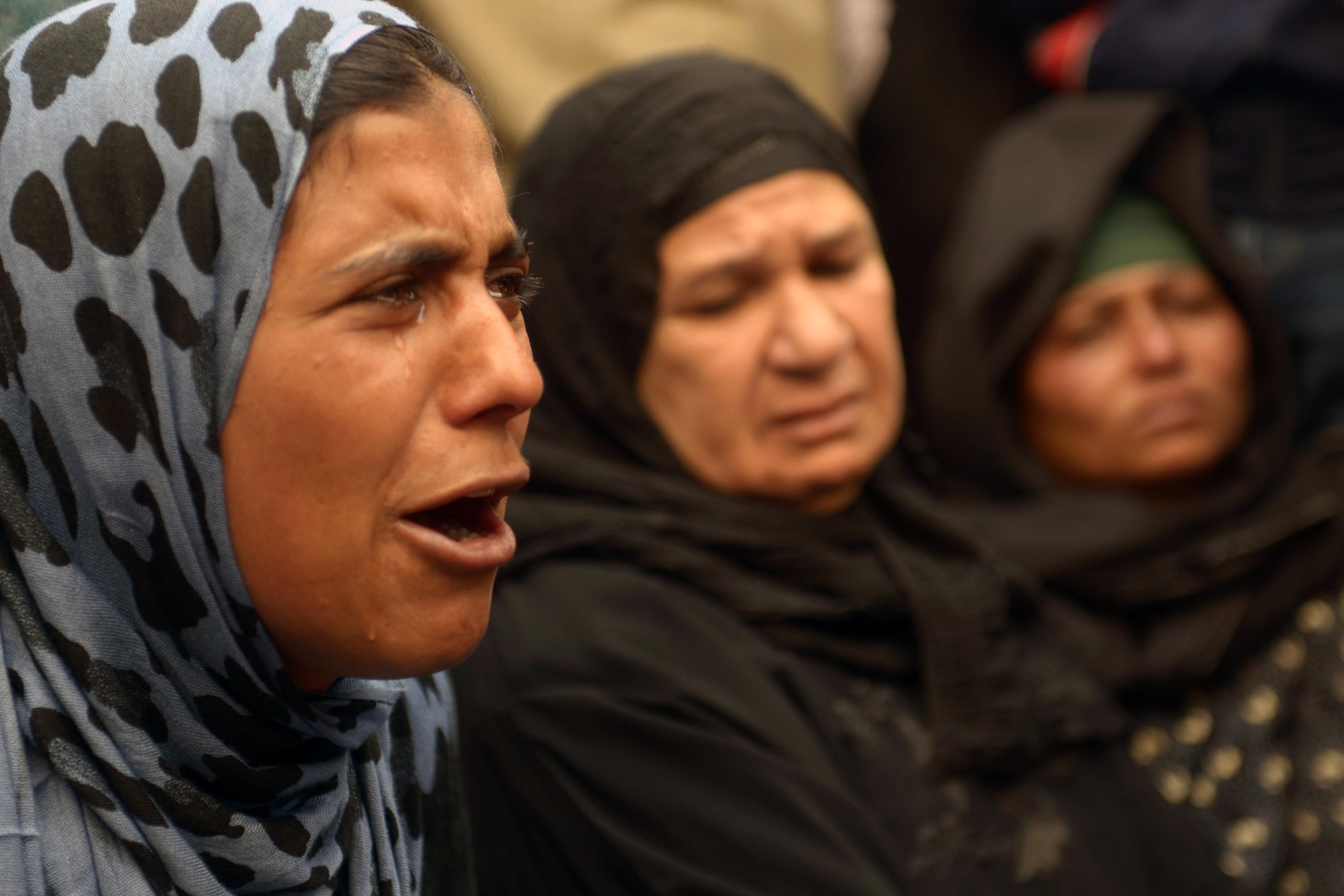 A relative of a supporter of Egyptian ousted Islamist president Mohamed Morsi cries outside the courthouse on March 25, 2014 in the central Egyptian city of Minya, during a session of the trial of some 700 Islamists charged with deadly rioting in an Egypt city. The court that the day before sentenced to death 529 alleged supporters of Morsi will sentence nearly 700 more on April 28, a lawyer said, after the hearing was adjourned.  (AFP PHOTO / STR)