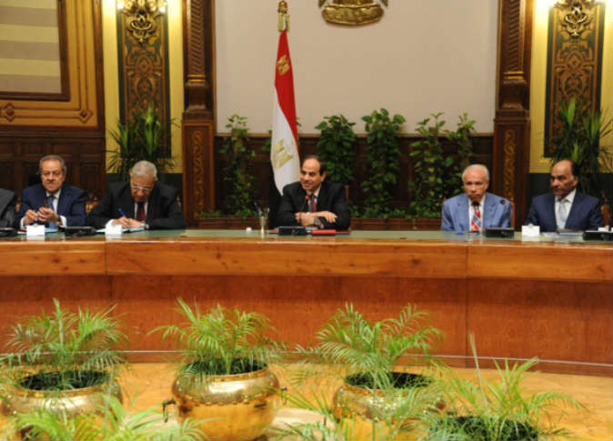 Al Sisi with a group of business man during a meeting held during a breakfast banquet.  (Photo Presidency handout)