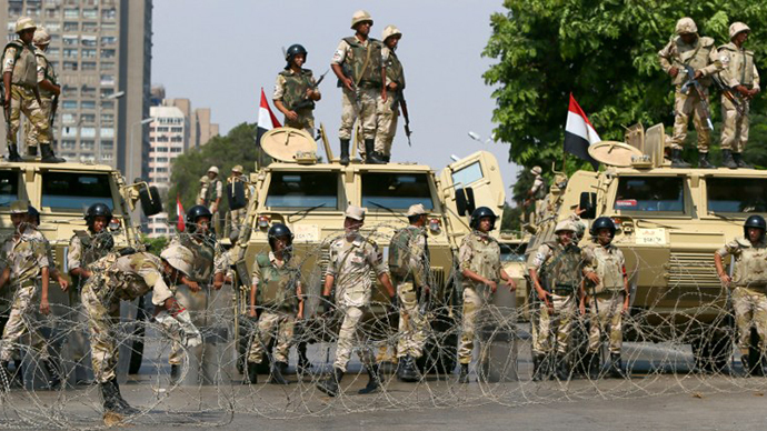 Egyptian army soldiers block Salah Salem highway to prevent supporters of the Muslim Brotherhood and ousted Egyptian president Mohamed Morsi from crossing during their demonstration in Cairo, on July 19, 2013.  (AFP Photo / Marwan Naamani)
