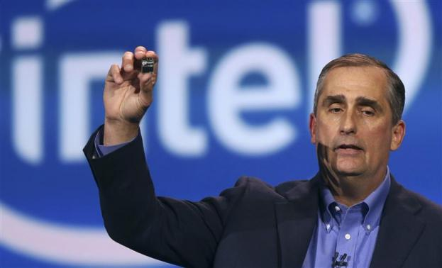 Intel CEO Brian Krzanich introduces Intel's Edison, a new personal computer in the size of an SD card, during the annual Consumer Electronics Show (CES) in Las Vegas, Nevada on 6 January 2014. (REUTERS/Robert Galbraith)