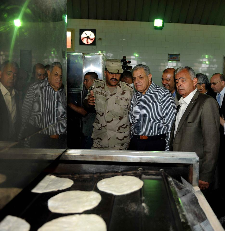 The government will announce the master plan of the Suez Canal development project in January 2015 Photo of Mehleb in his Wednesday visit to Suez (Cabinet handout)