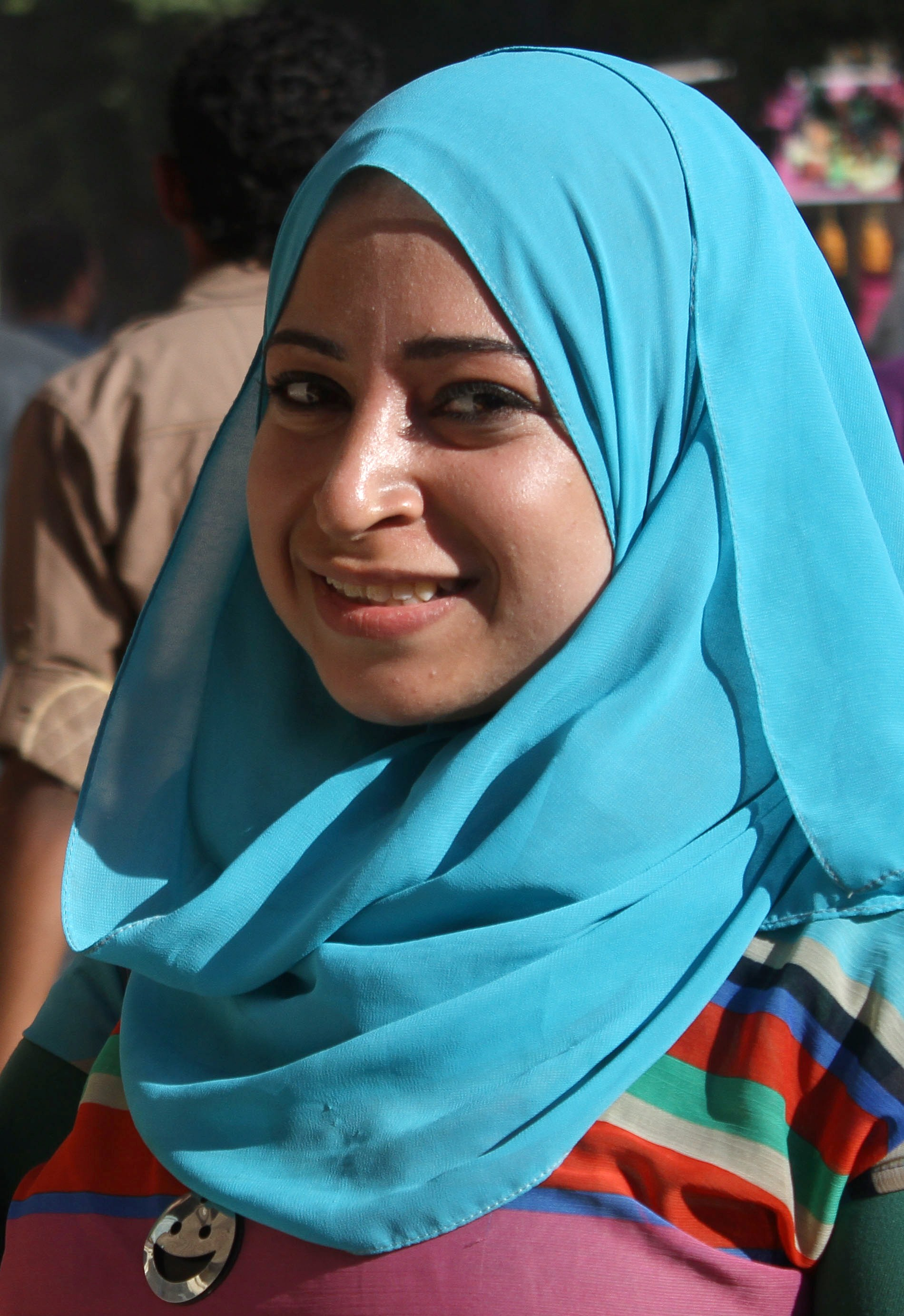 Egyptian journalist, Mayada Ashraf poses as she covers a protest of Islamists against ex-army chief Abdel Fattah al-Sisi's presidency bid on March 28, 2014 in the northern neighbourhood of Ein Shams, outside Cairo. Mayada Ashraf, who worked for privately owned Al-Dustour newspaper and freelanced for news website Masr Alarabia, was shot in the head while covering the clashes.   (AFP PHOTO / MAHMOUD BAKKAR)