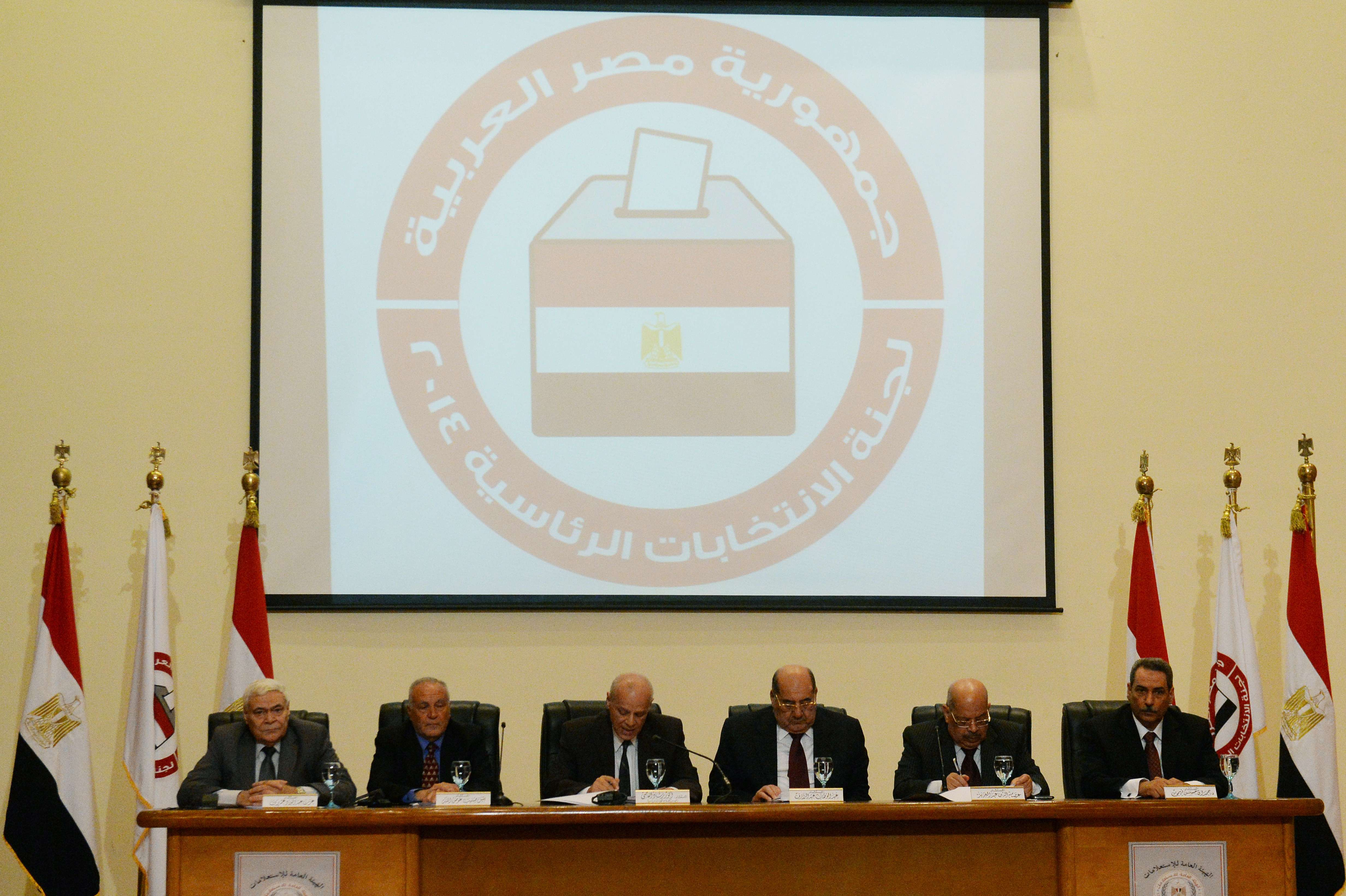 Egyptian judge, Anwar Rashad al-Assi (3rd L), head of the presidential Electoral Commission, attends a press conference in Cairo on March 30, 2014, to announce the timetable for the upcoming presidential election. Egypt is to hold a presidential election on May 26-27, 10 months after the army turfed out Islamist leader Mohamed Morsi from the presidency, the electoral commission announced. The election would go into a second round on June 16-17 if there is no outright winner.  (AFP PHOTO / KHALED DESOUKI)