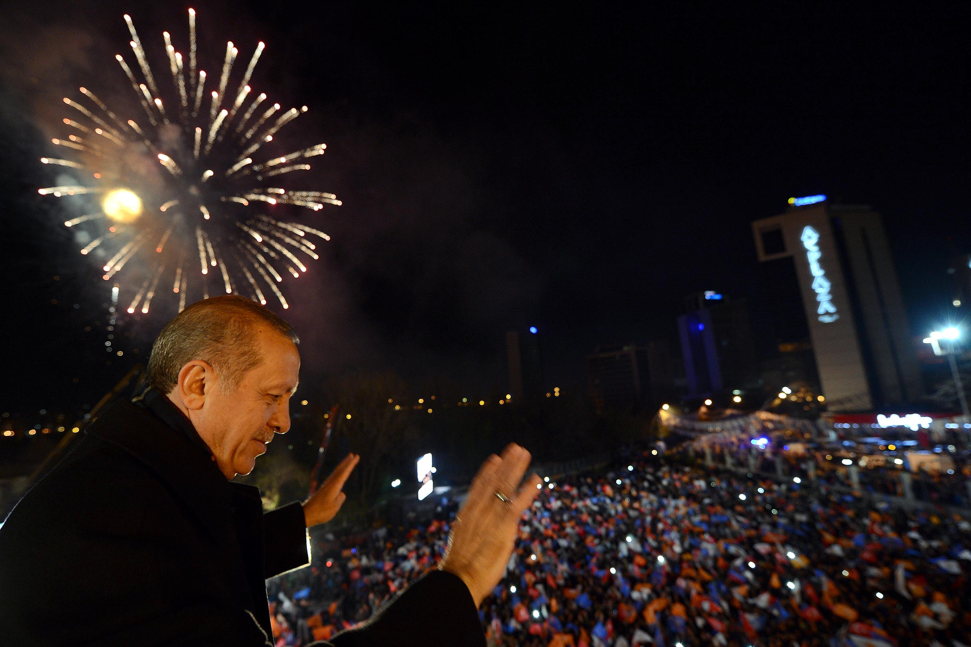 "A March 30, 2014 handout picture released by the Prime Minister Press Office shows Turkey's Prime Minister Tayyip Erdogan greets his supporters in Ankara on March 30, 2014.   Turkey's Premier Recep Tayyip Erdogan claimed victory for his Islamic-rooted party in Sunday's key local elections and warned his foes they will ""pay the price"" for plotting his downfall.    AFP PHOTO/KAYHAN OZER/PRIME MINISTER PRESS OFFICE/HANDOUT    == RESTRICTED TO EDITORIAL USE - MANDATORY CREDIT ""AFP PHOTO / KAYHAN OZER / PRIME MINISTER PRESS OFFICE"" - NO MARKETING NO ADVERTISING CAMPAIGNS - DISTRIBUTED AS A SERVICE TO CLIENTS ="