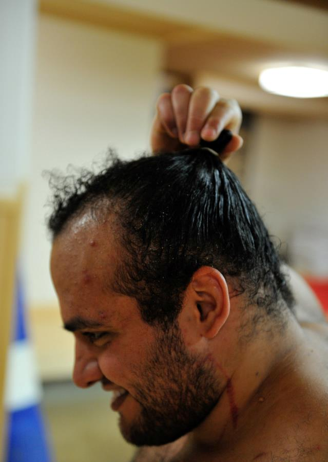 The well-known top-knot hairstyle of Sumo Wrestlers (Photo By Holy One,  Courtesy of Abdelrahman Shaalan)