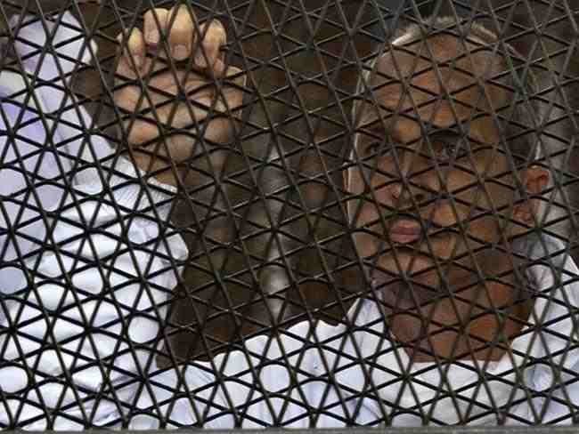 Australian journalist Peter Greste inside the defendants' cage at Cairo's Tora prison on March 5.  (AFP Photo)