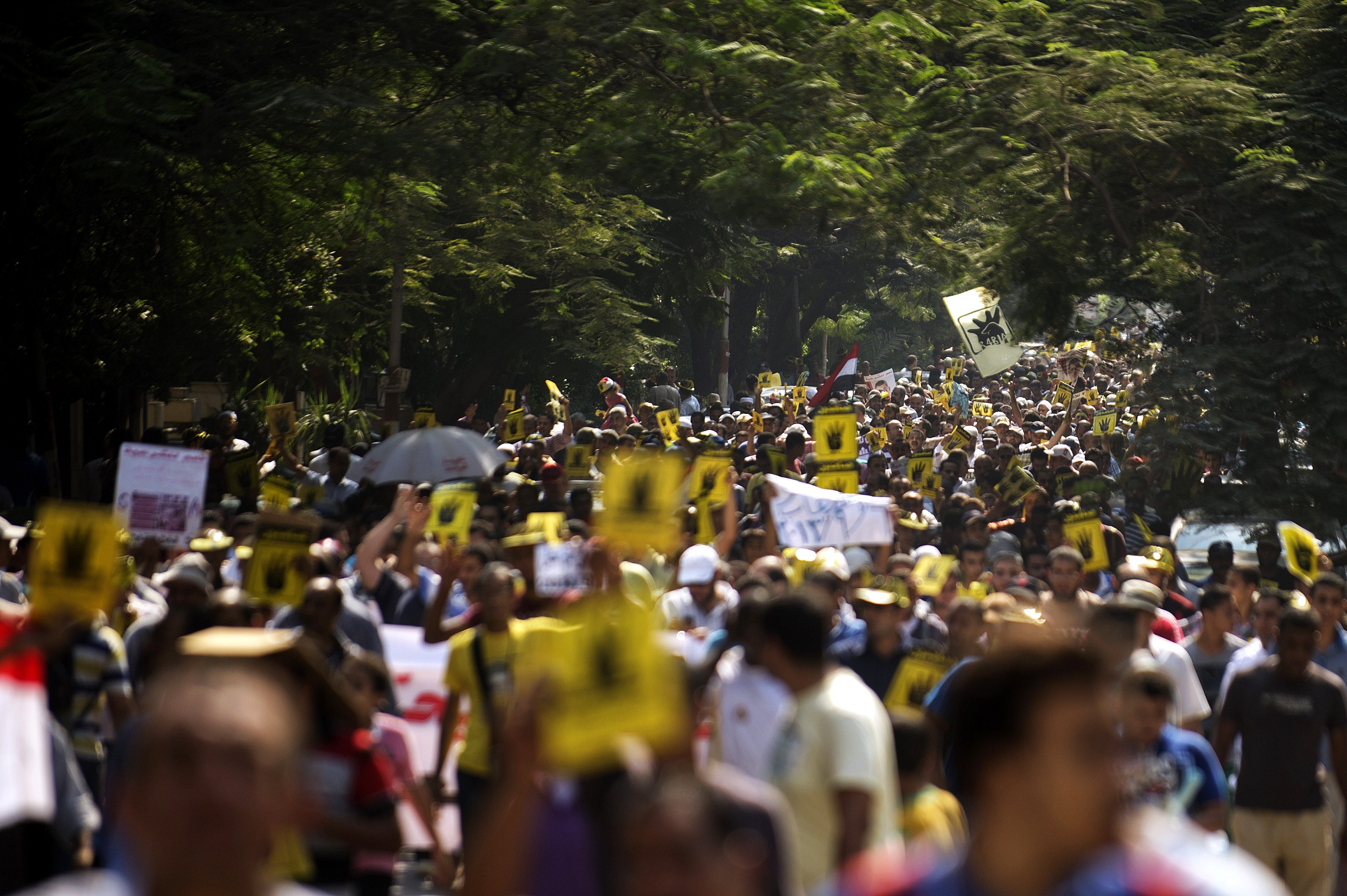 Members of the Muslim Brotherhood and supporters of ousted President Mohamed Morsi march through Cairo's Maadi Neighborhood on September 6, 2013.  (AFP Photo)