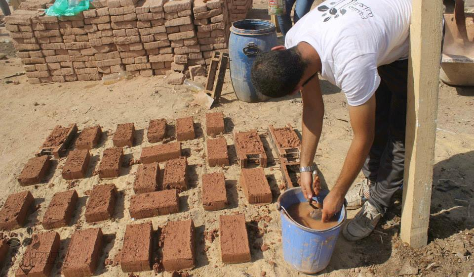 Instead of regular red brick, Ezbet team makes bricks which made from only natural materials such as mud and straw (Photo Handout from Ezbet Project Facebook Page)