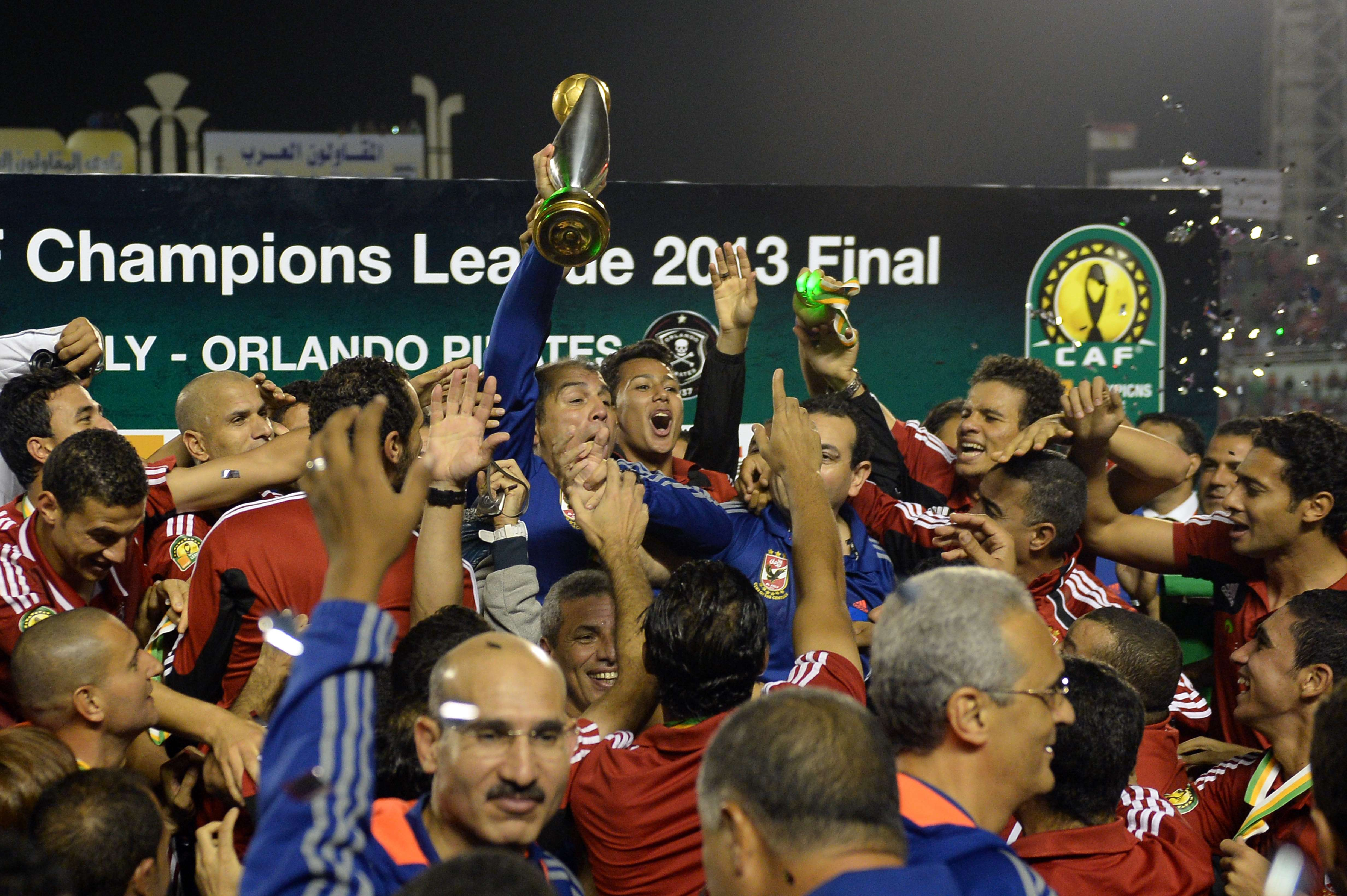 Egyptian al-Ahly coach Mohamed Youssef holds up the African Champions League trophy in Cairo, after defeating Orlando Pirates of South Africa 2-0 in the second leg of the final (AFP PHOTO / KHALED DESOUKI)