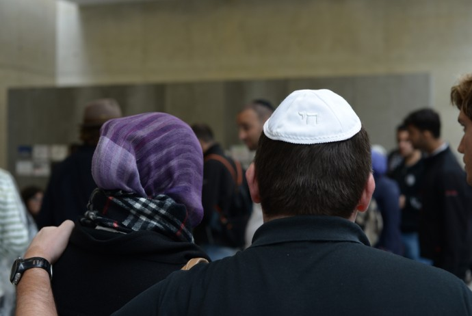 A Jew and a Muslim embrace at the Muslim Jewish Conference in Vienna in August (Photo Courtesy of the Muslim Jewish Conference)