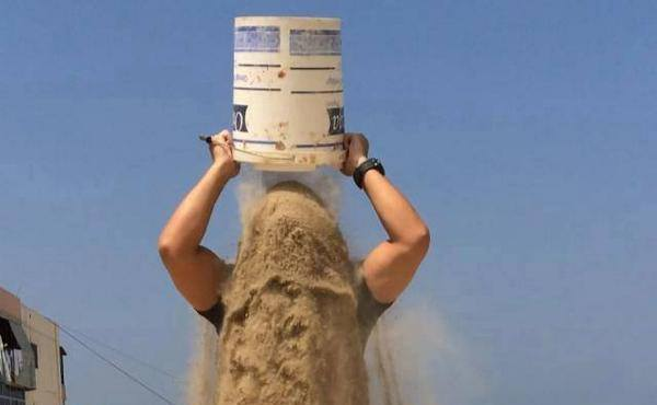 "Maysam Abumorr launches ""The Rubble Bucket Challenge"" to raise awareness about the situation in Gaza (Photo Handout from The Rubble Bucket Challenge Facebook page)"