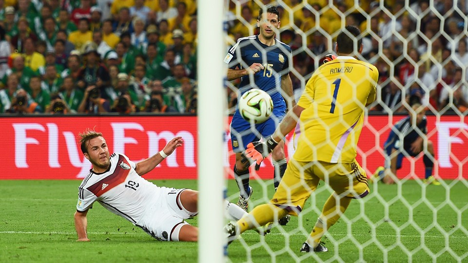 Mario Goetze of Germany scores his team's first goal past Sergio Romero of Argentina in extra time during the 2014 FIFA World Cup Brazil Final match between Germany and Argentina at Maracana on July 13, 2014 in Rio de Janeiro, Brazil.  (Photo by Laurence Griffiths/Getty Images)