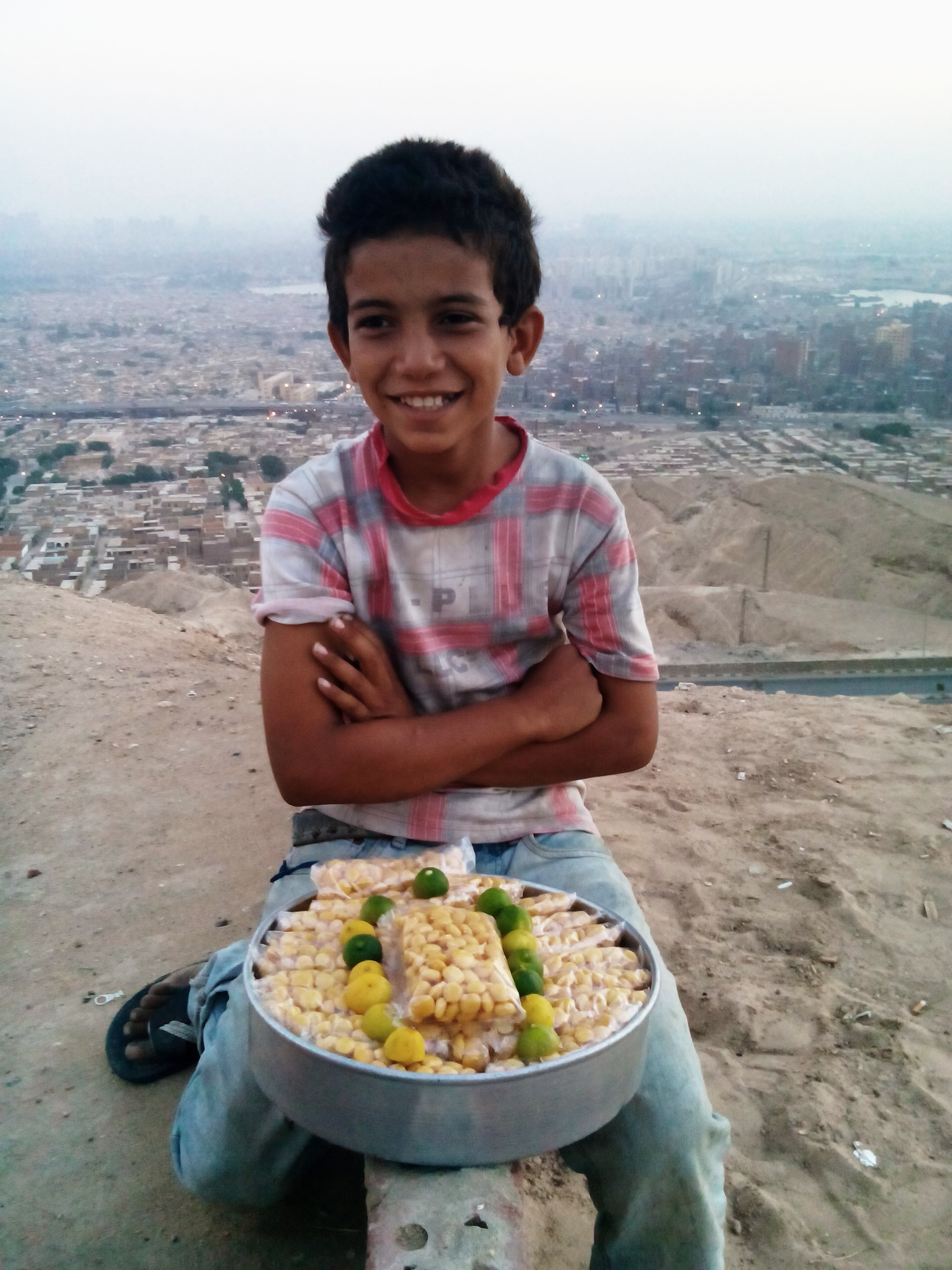 """Gamal, 11, sells lupine grain in a photo posted on the Facebook page """"Humans of Cairo"""" (Photo by Salma Hegab)"""
