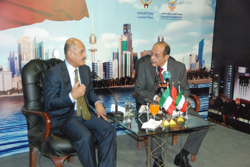 Badr Al-Humaidi in the left during his conference which held in Kuwait's division in Cairo International Book Fair  (Photo courtesy of Kuwait's division)