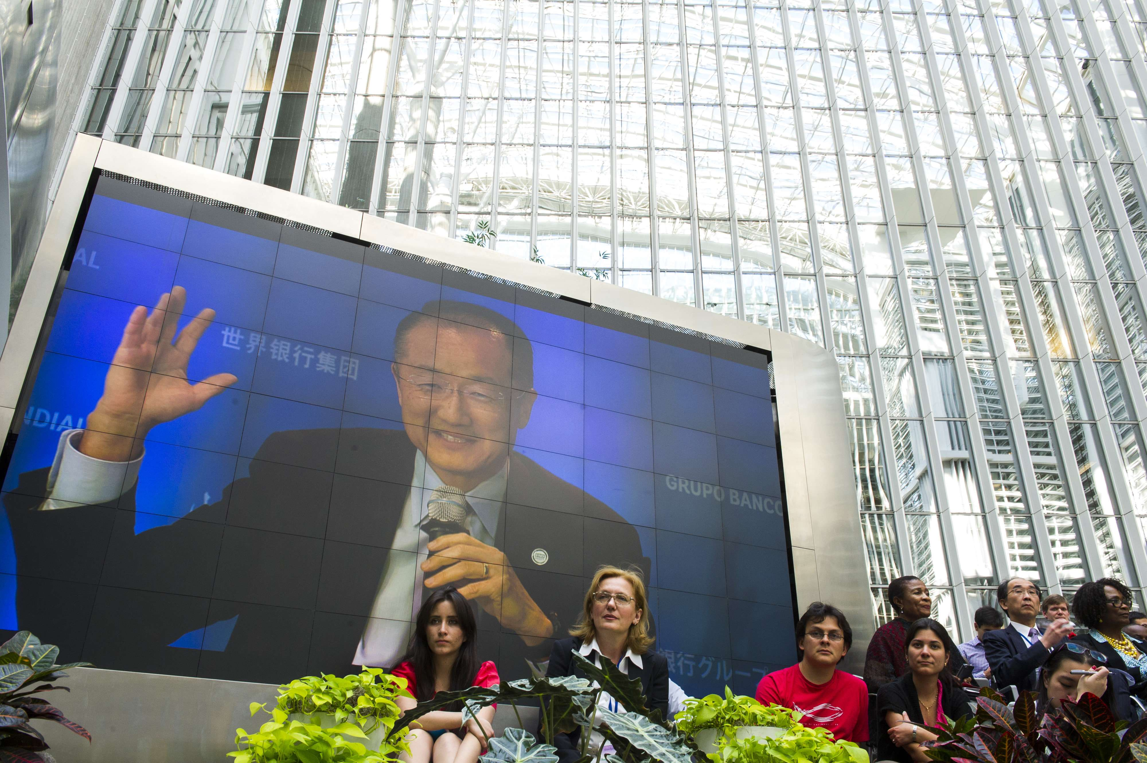 """World Bank Group President Jim Yong Kim is seen on a large screen as he addresses a discussion on """"Sharing Prosperity, Delivering Results"""" during the IMF/World Bank Spring Meetings in Washington on April 11, 2014.    AFP PHOTO/ROD LAMKEY JR"""