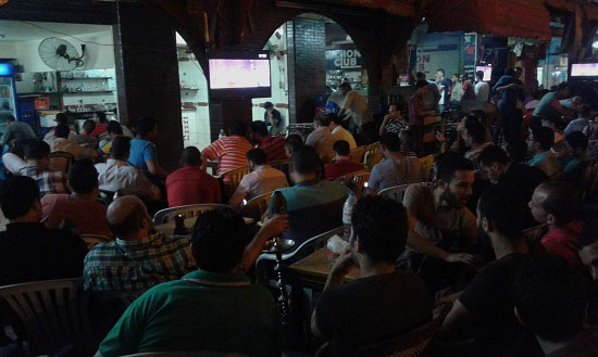 For a lot of Egyptians, there is nothing better than watching a football match while drinking mint-flavored tea and smoking shisha, and babbling with their friends about the players' performance.