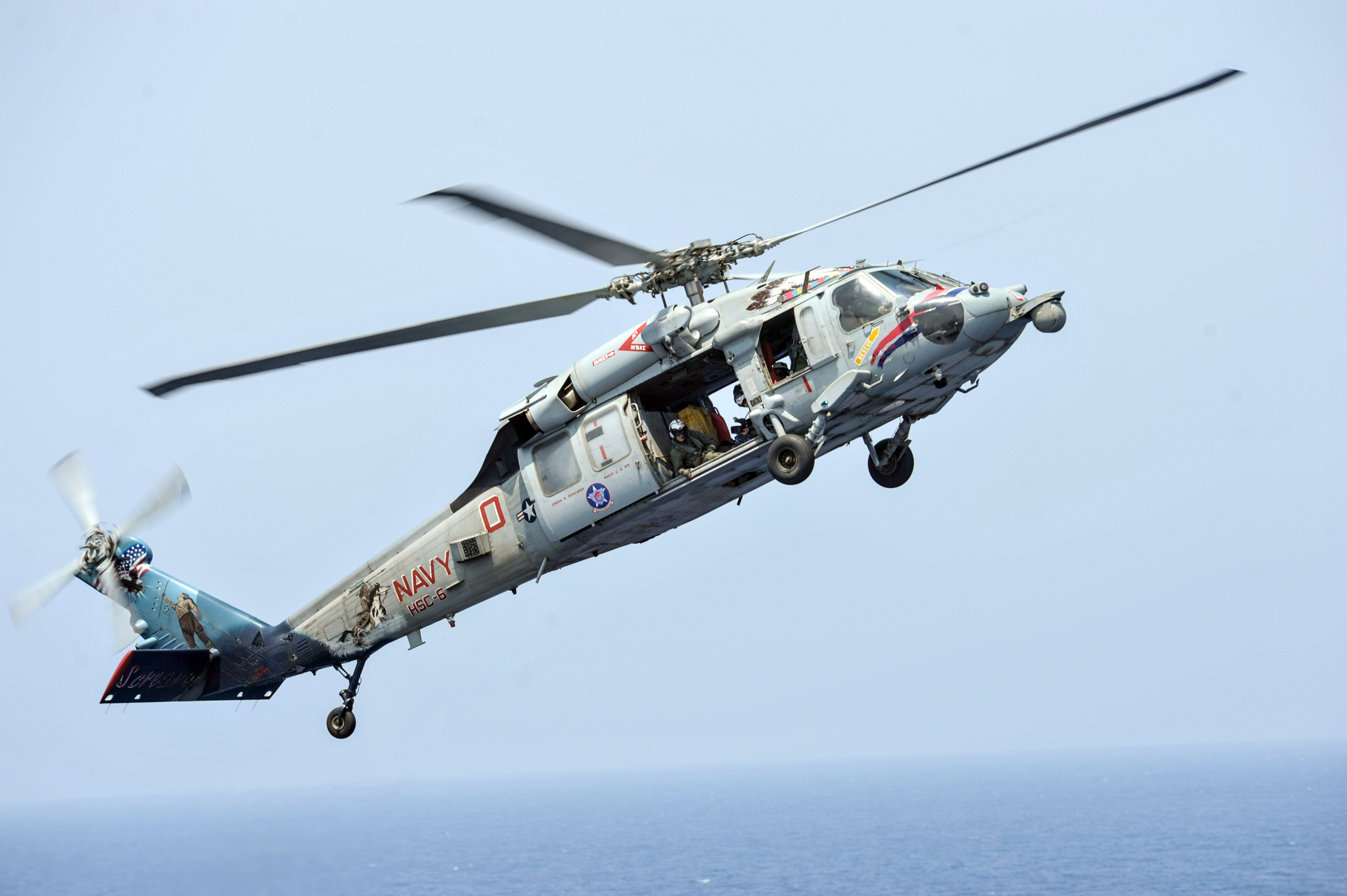 This September 7, 2013 handout image provided by the US Navy shows an MH-60S Sea Hawk helicopter assigned to the Indians of Helicopter Sea Combat Squadron (HSC) 6 preparing to land on the flight deck of the aircraft carrier USS Nimitz (CVN 68). (AFP File Photo)