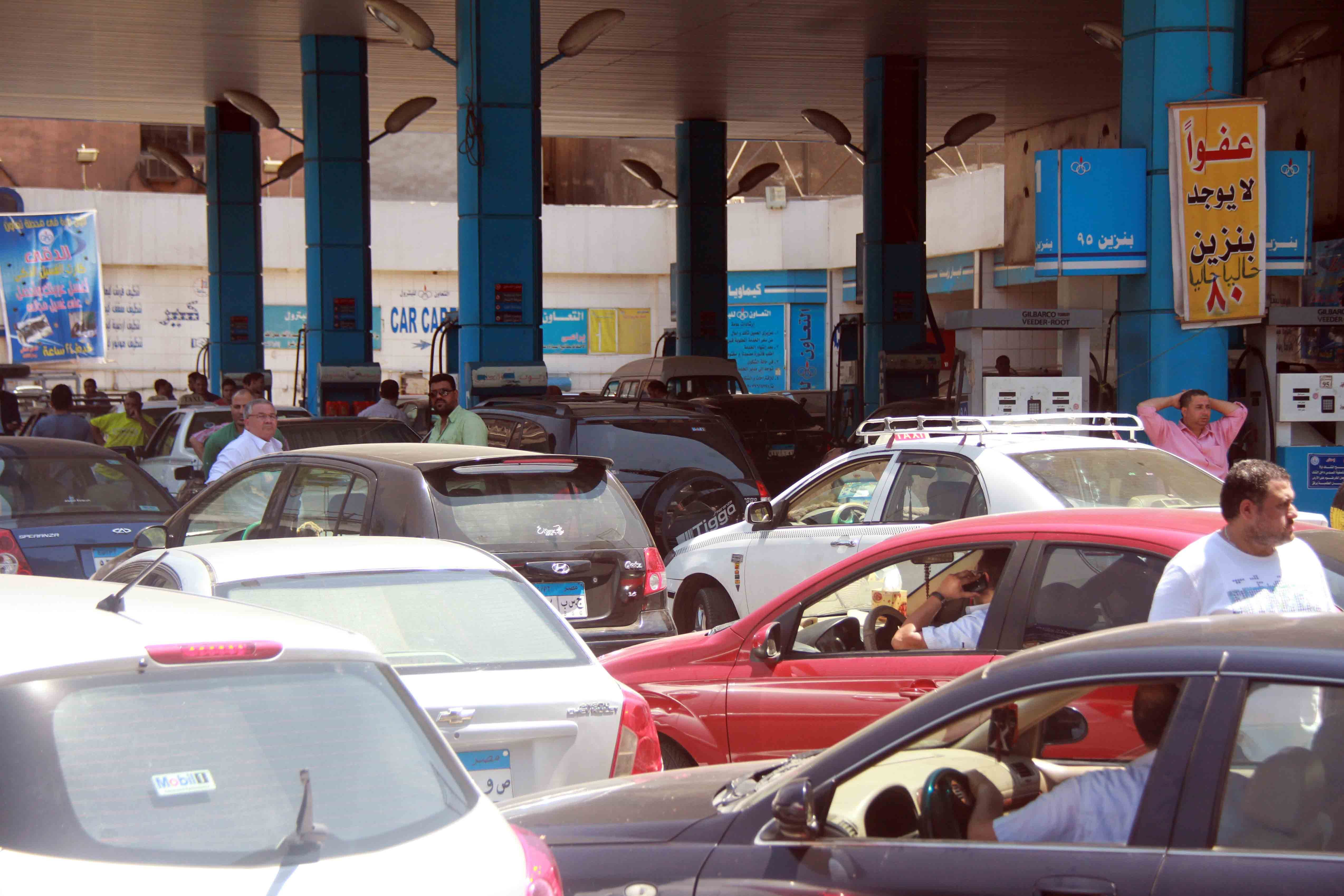 Cars queue up for gas amid rising fuel prices. The premature removal of energy subsidies, which consume EGP 128bn of the state's budget, would have a serious impact on Egypt's middle class and poor. (Photo by Mohamed Omar)