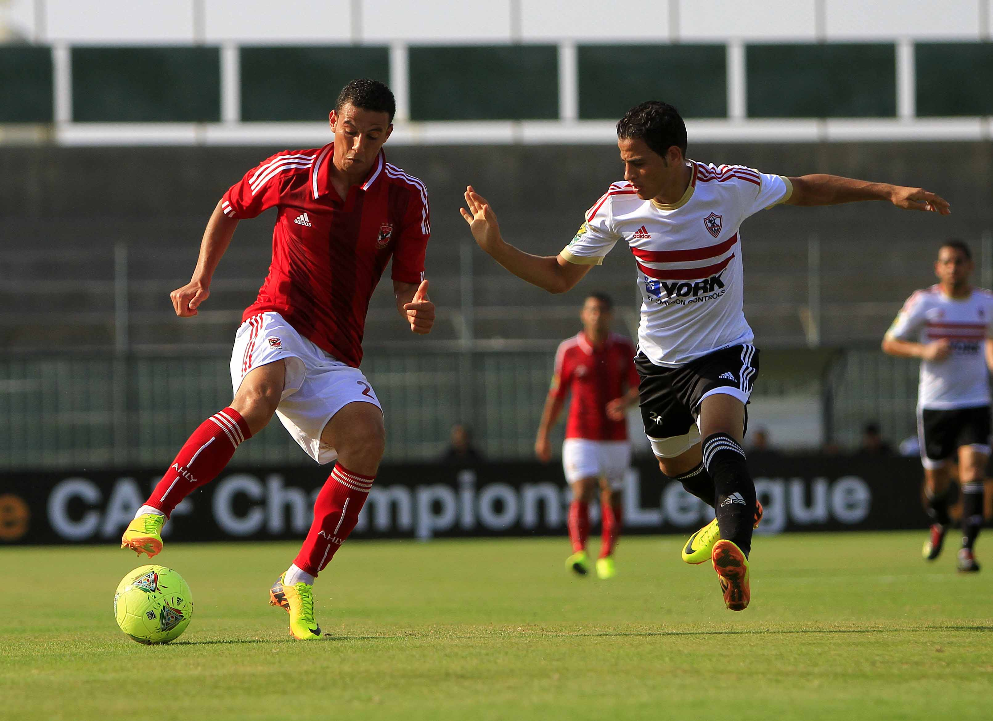 Ahmad Abdel-Zaher of Al-Ahly and Ahmad Tawfik of Zamalek challenge for the ball in the Cairo derby match last Sunday. (Photo by Ahmed Al-Malky)
