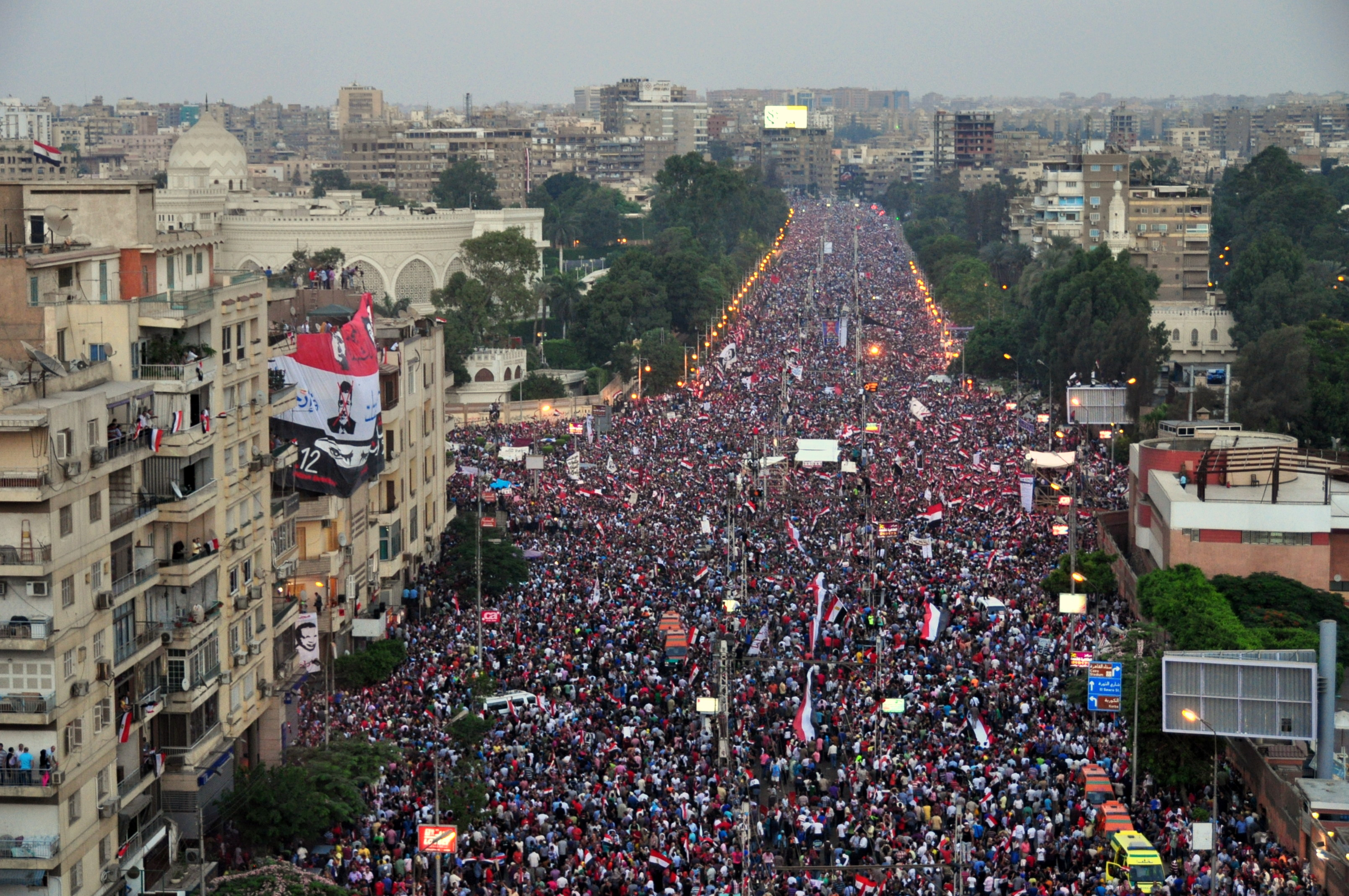 Egyptian demonstrators gather outside the presidential palace in Cairo on June 30, 2013. (Photo by Aaron T.Rose\DNE)
